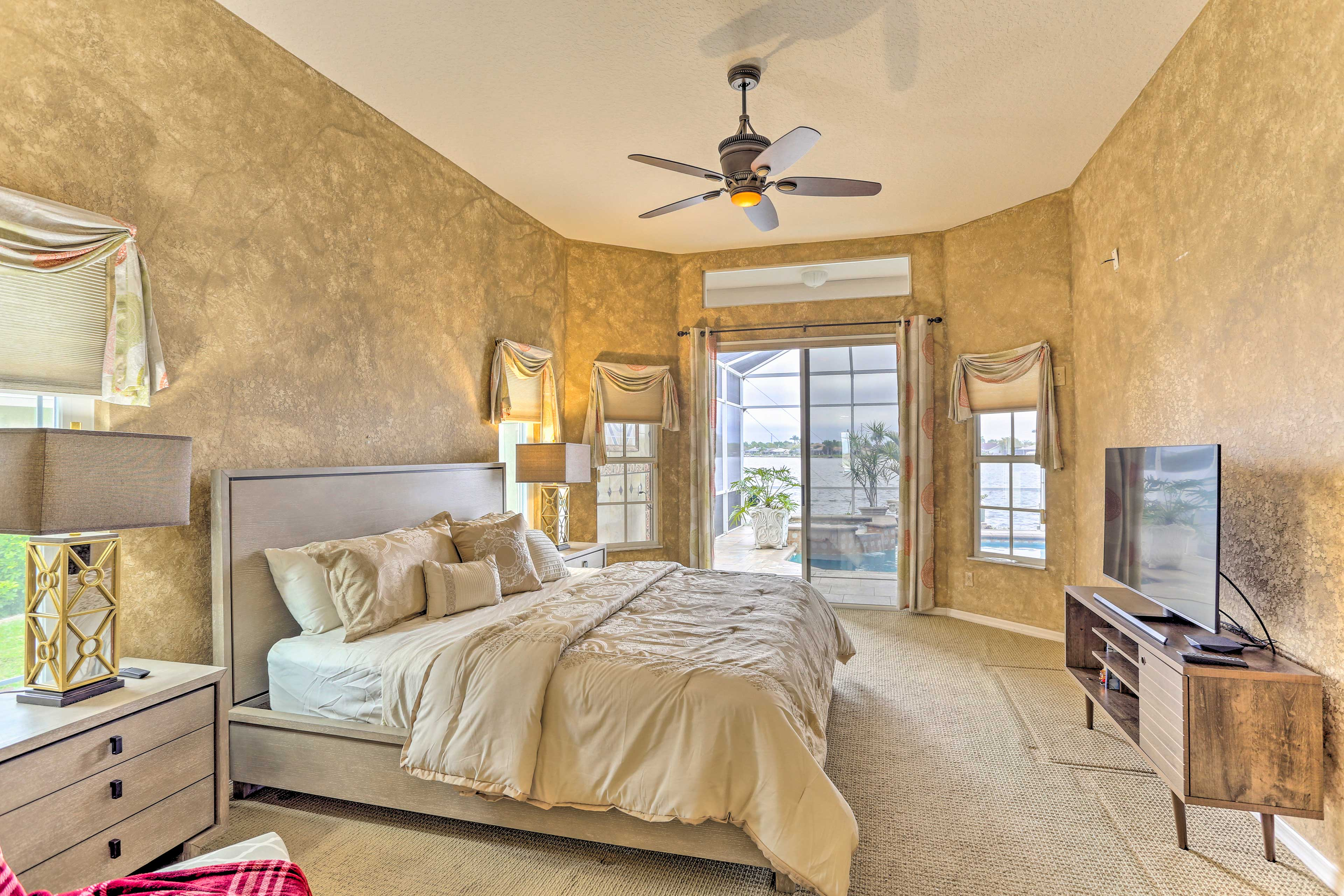 Off the living room and with patio access, you'll find the master bedroom.