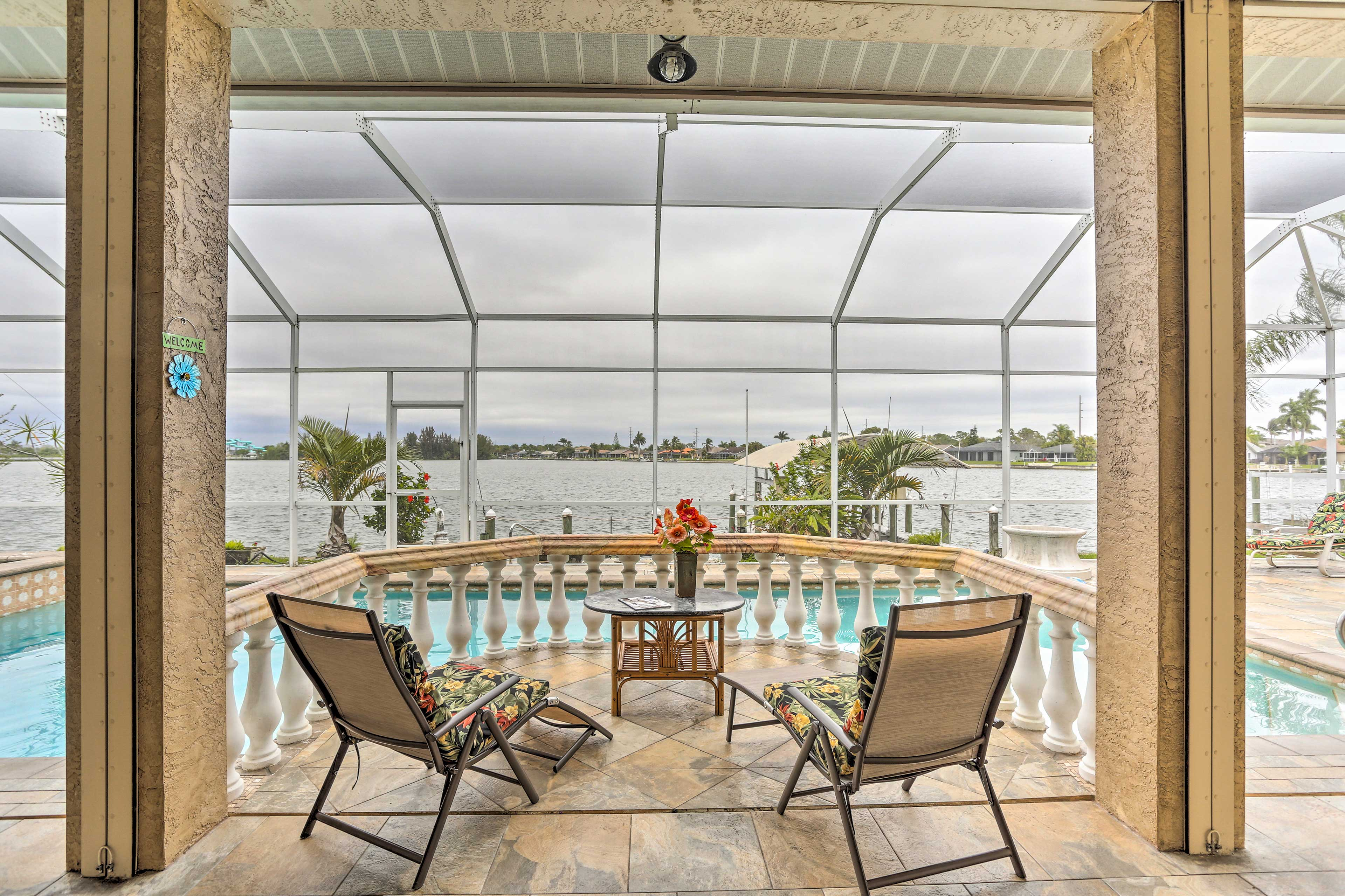Settle into this Cape Coral vacation rental's waterfront saltwater pool!