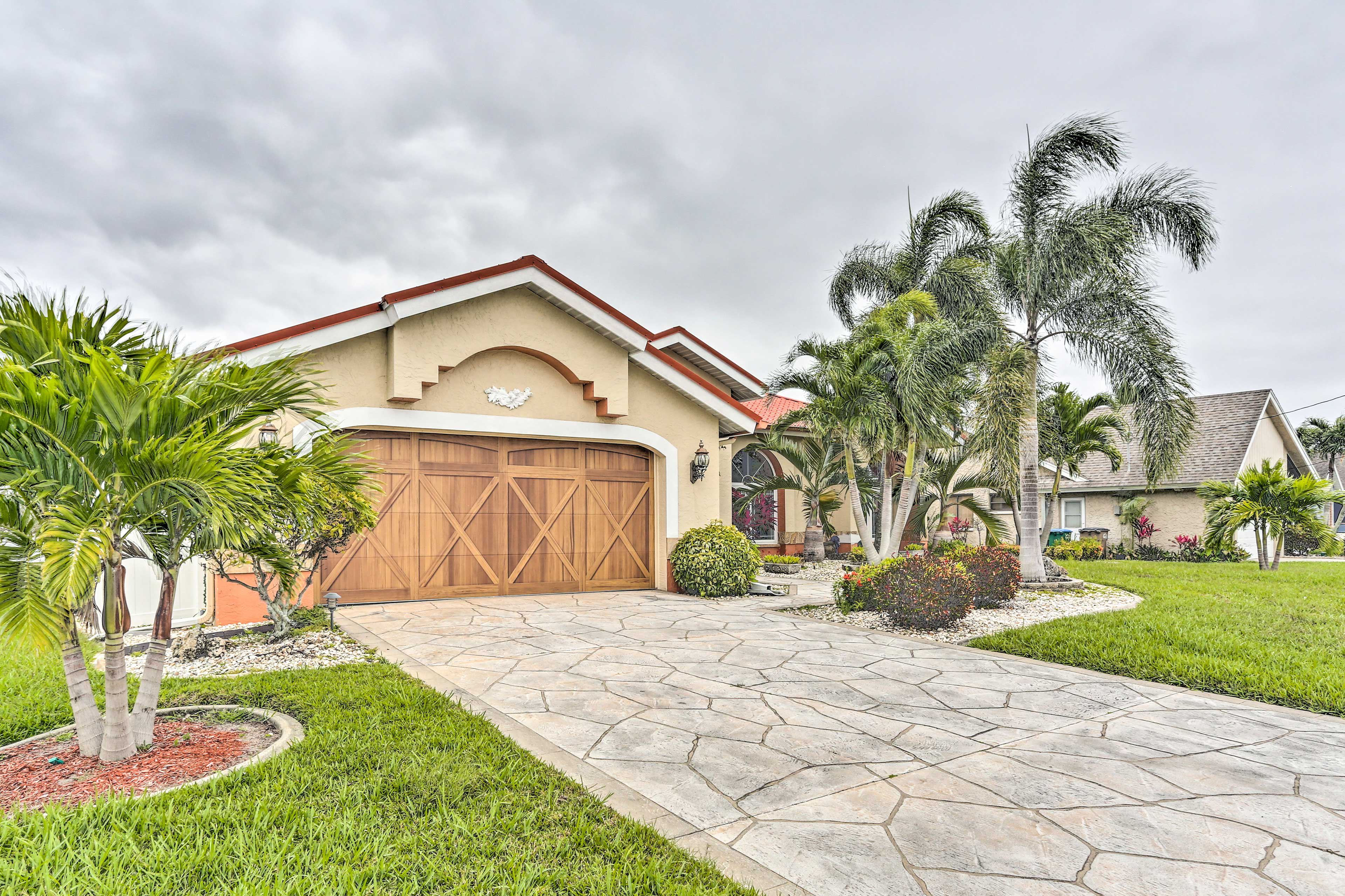 The beautiful garage door and styled driveway provide added curb appeal.