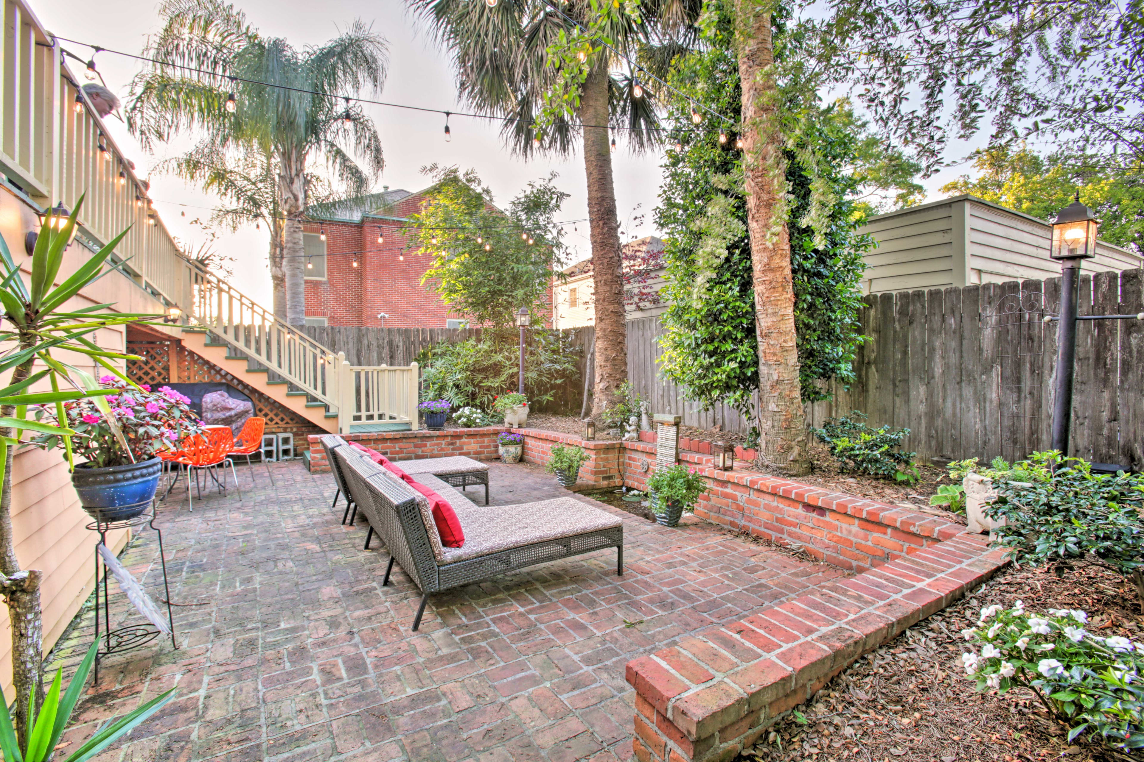 This spacious NOLA home base offers a lush garden with a waterfall!