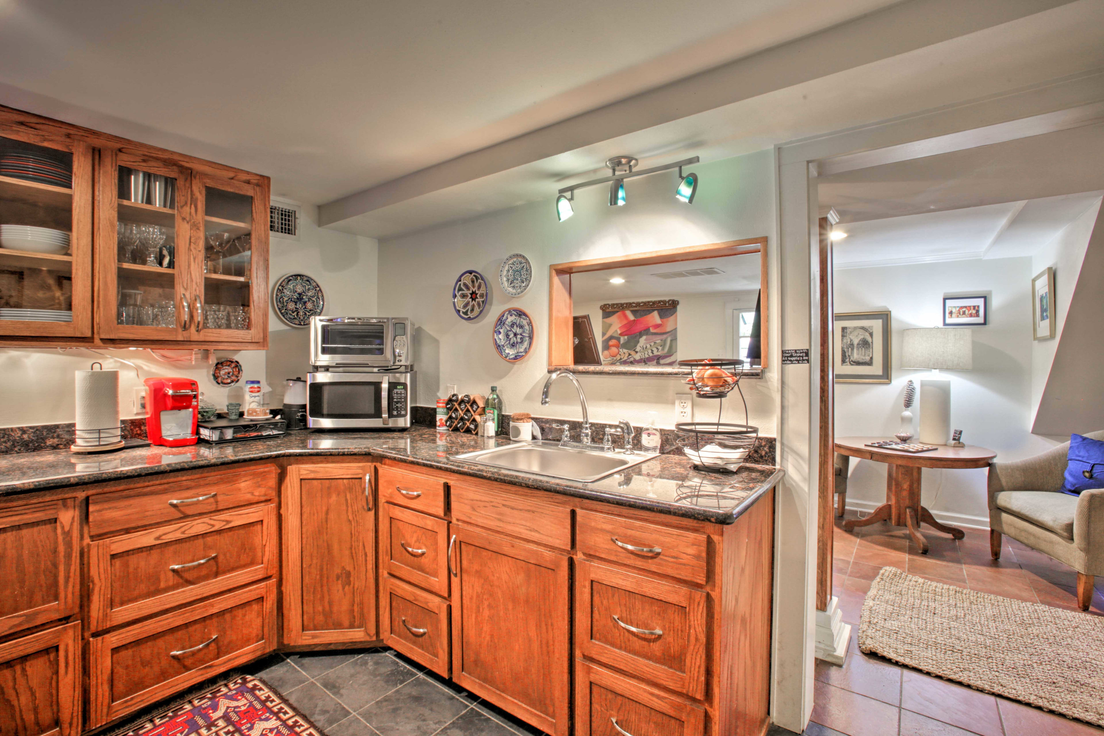 The kitchenette offers a microwave, toaster oven, and a Keurig.