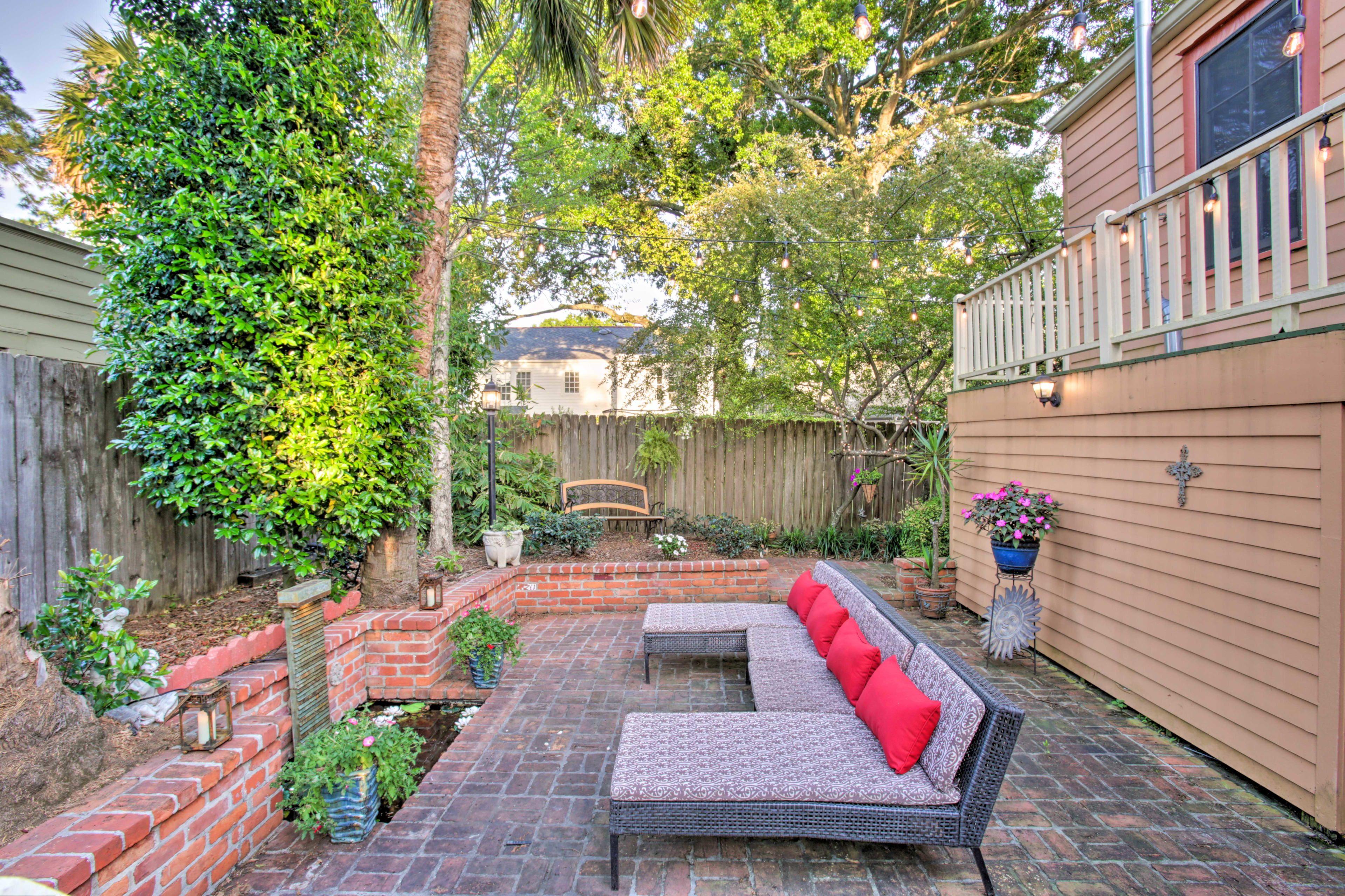Unwind on the patio furniture and enjoy plenty of privacy at the outdoor space.