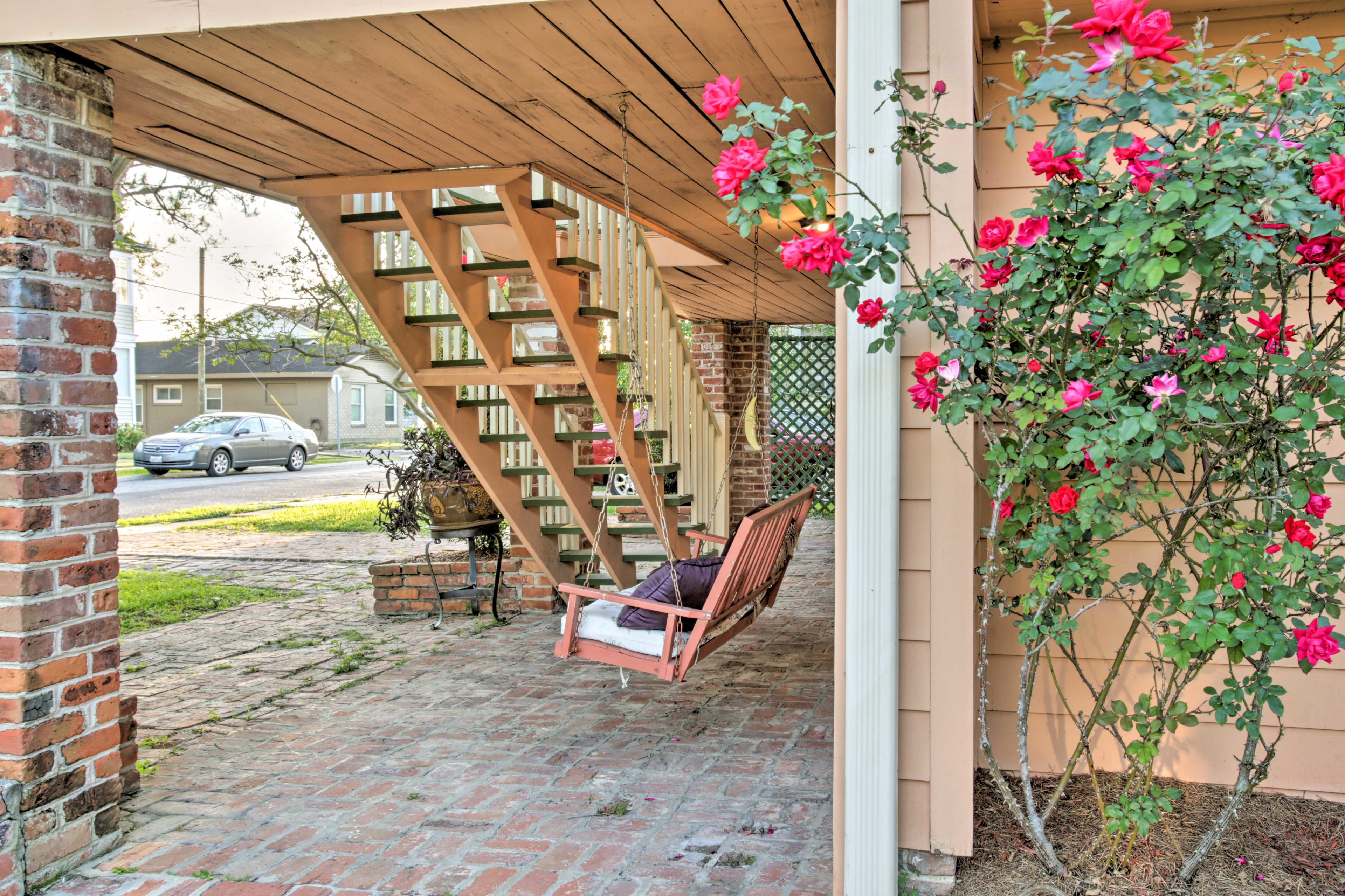 The chair swing in front of the house is a wonderful reading nook.