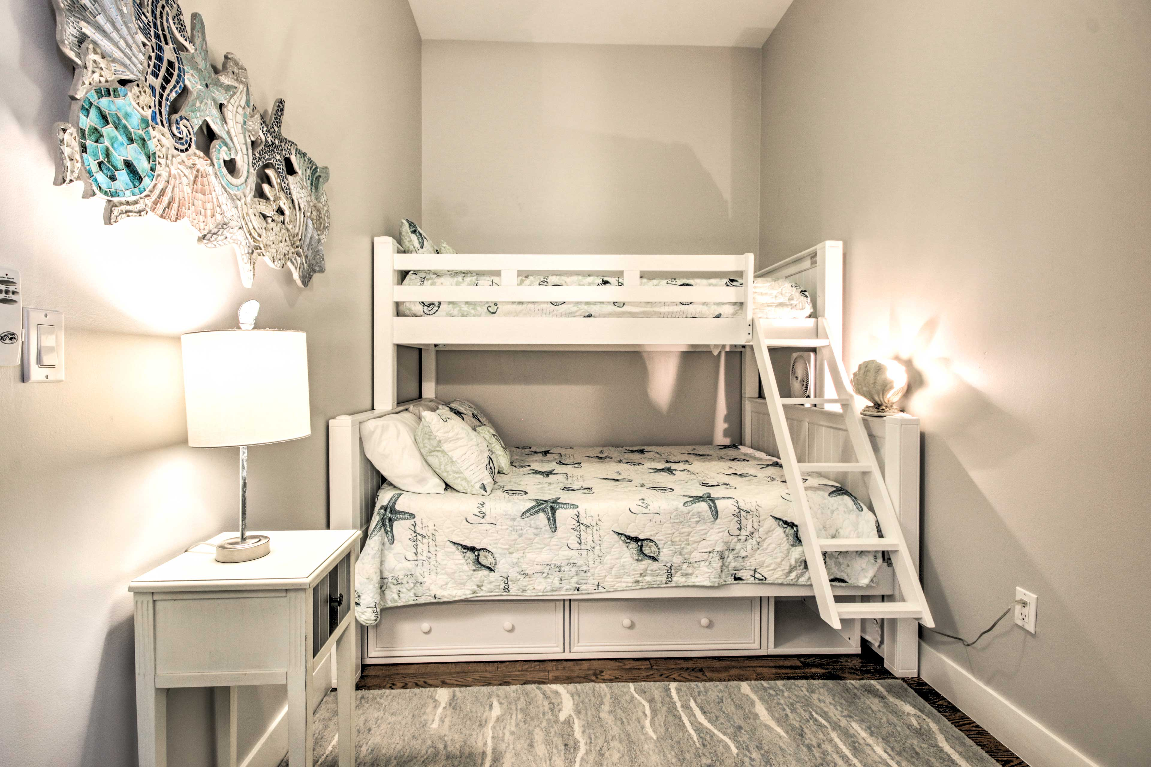 The third bedroom has a XL twin/queen bunk bed for 3 guests.