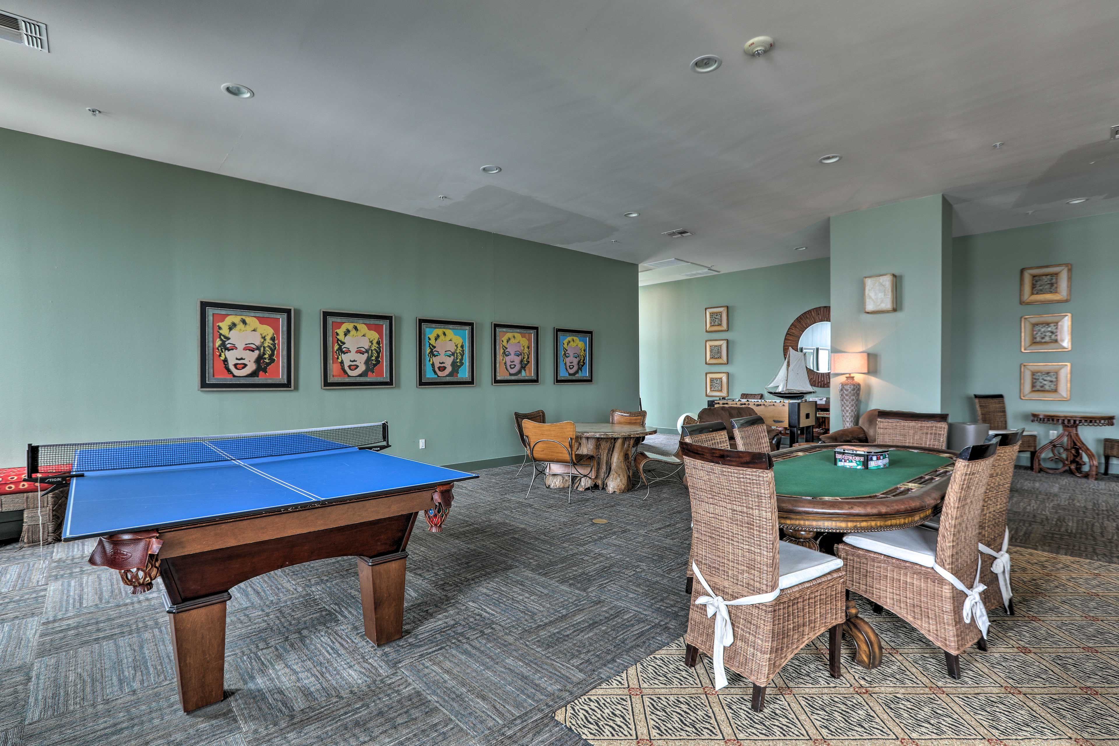 This space also offers a poker table and a foosball table.