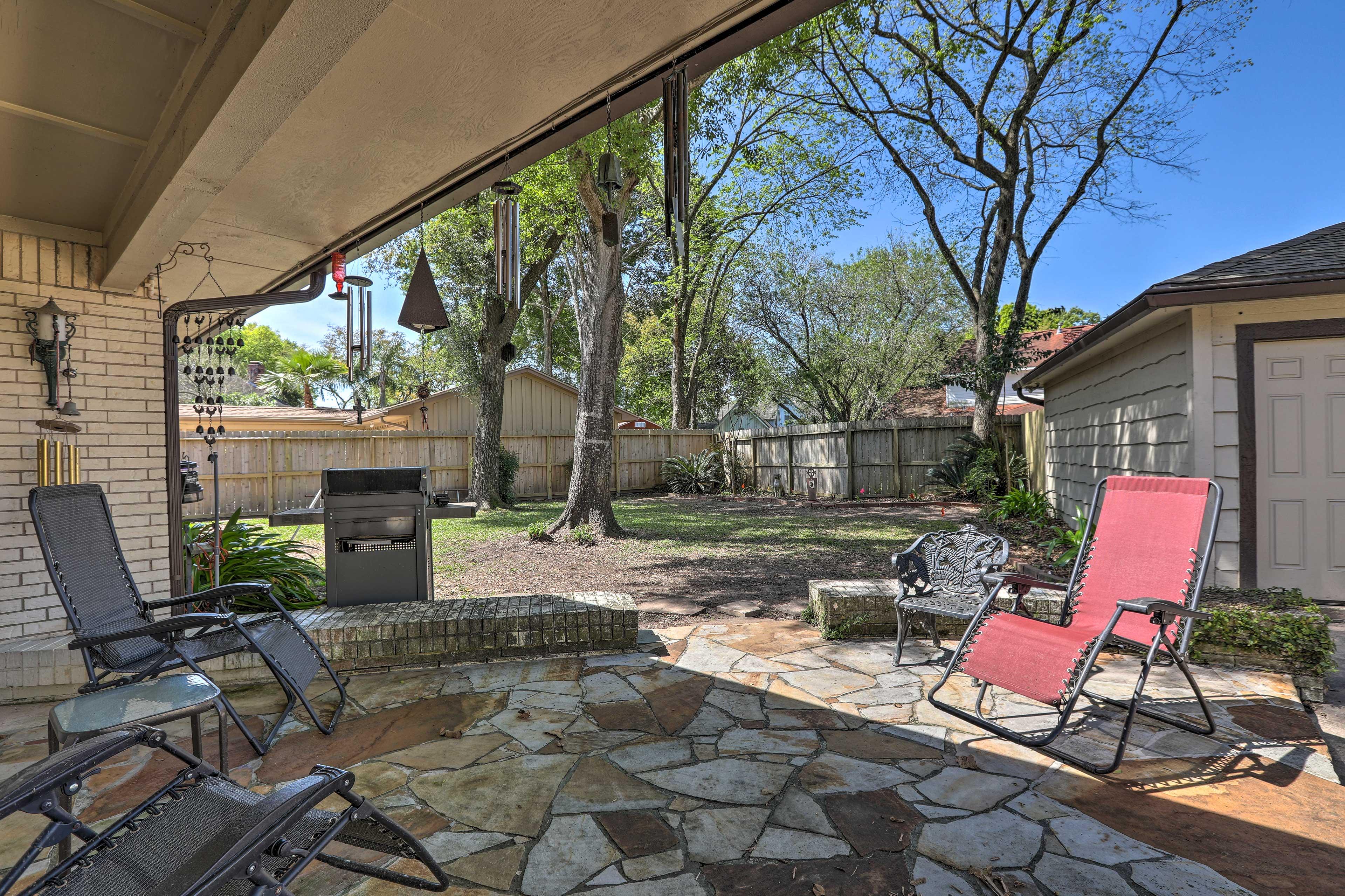 The backyard boasts a seating area.
