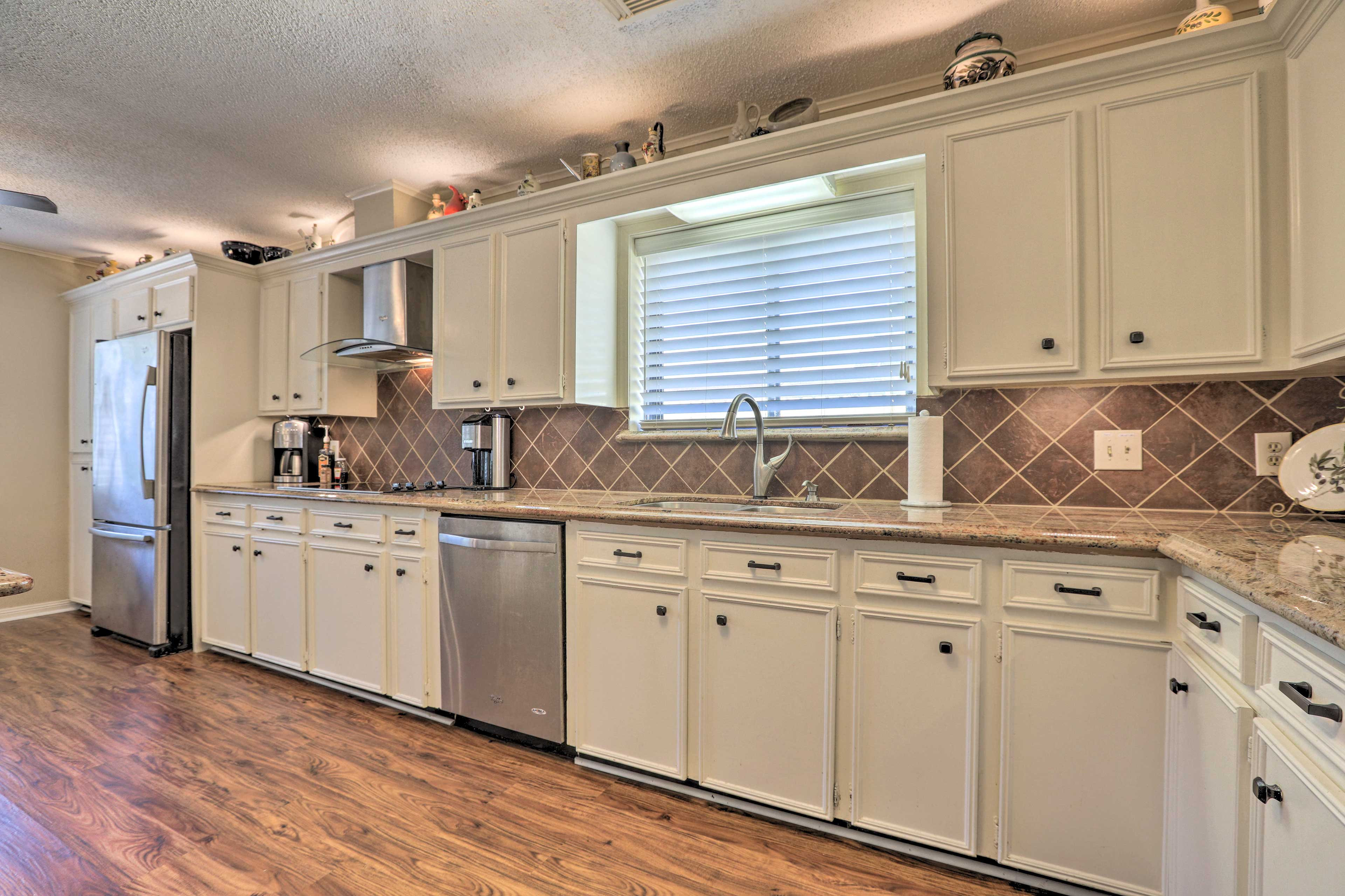 The fully equipped kitchen makes it easy to prepare home-cooked meals.