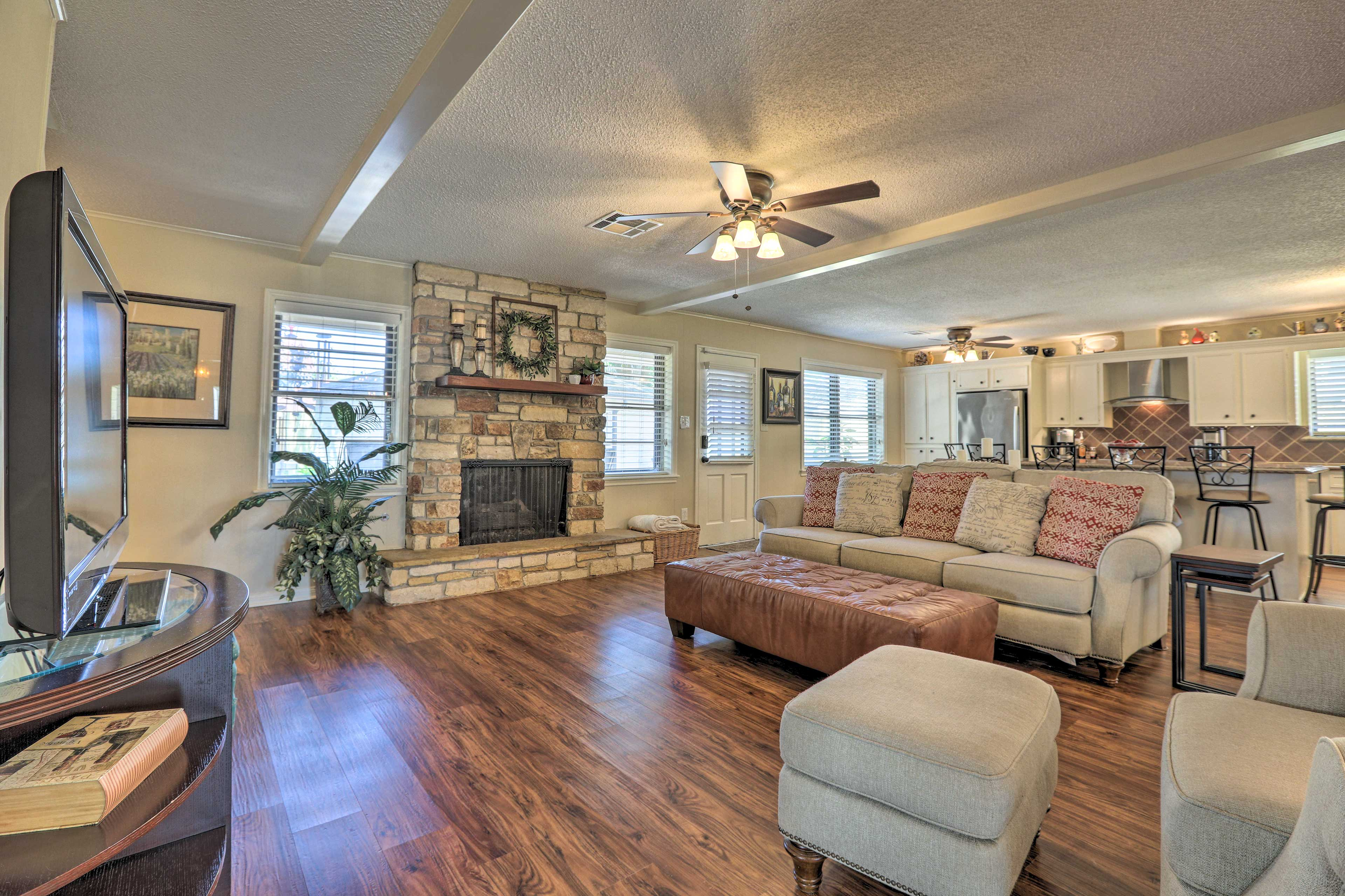 The living room boasts a fireplace and flat-screen TV.