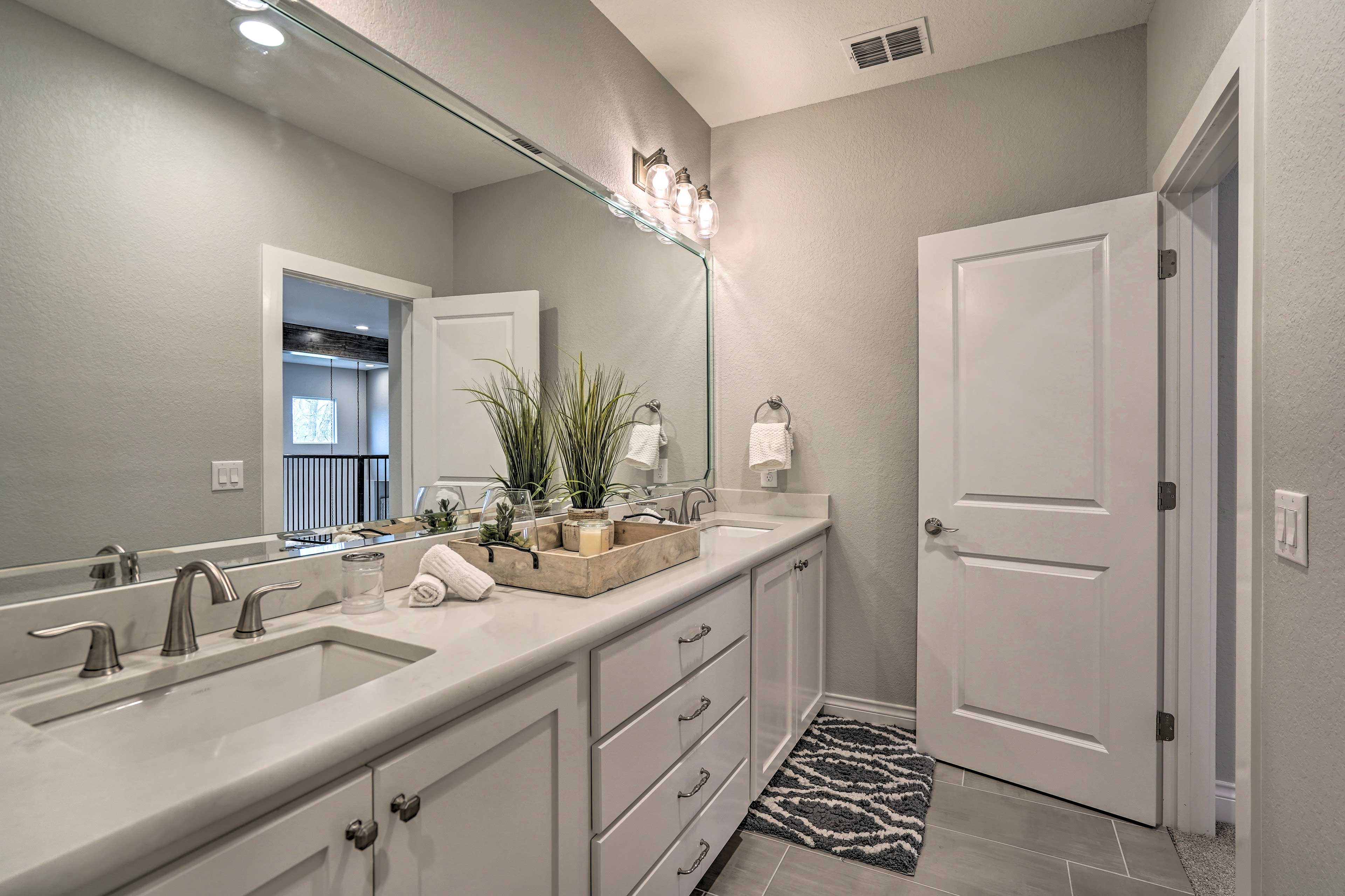 His-and-hers sinks make this bathroom easy to share.
