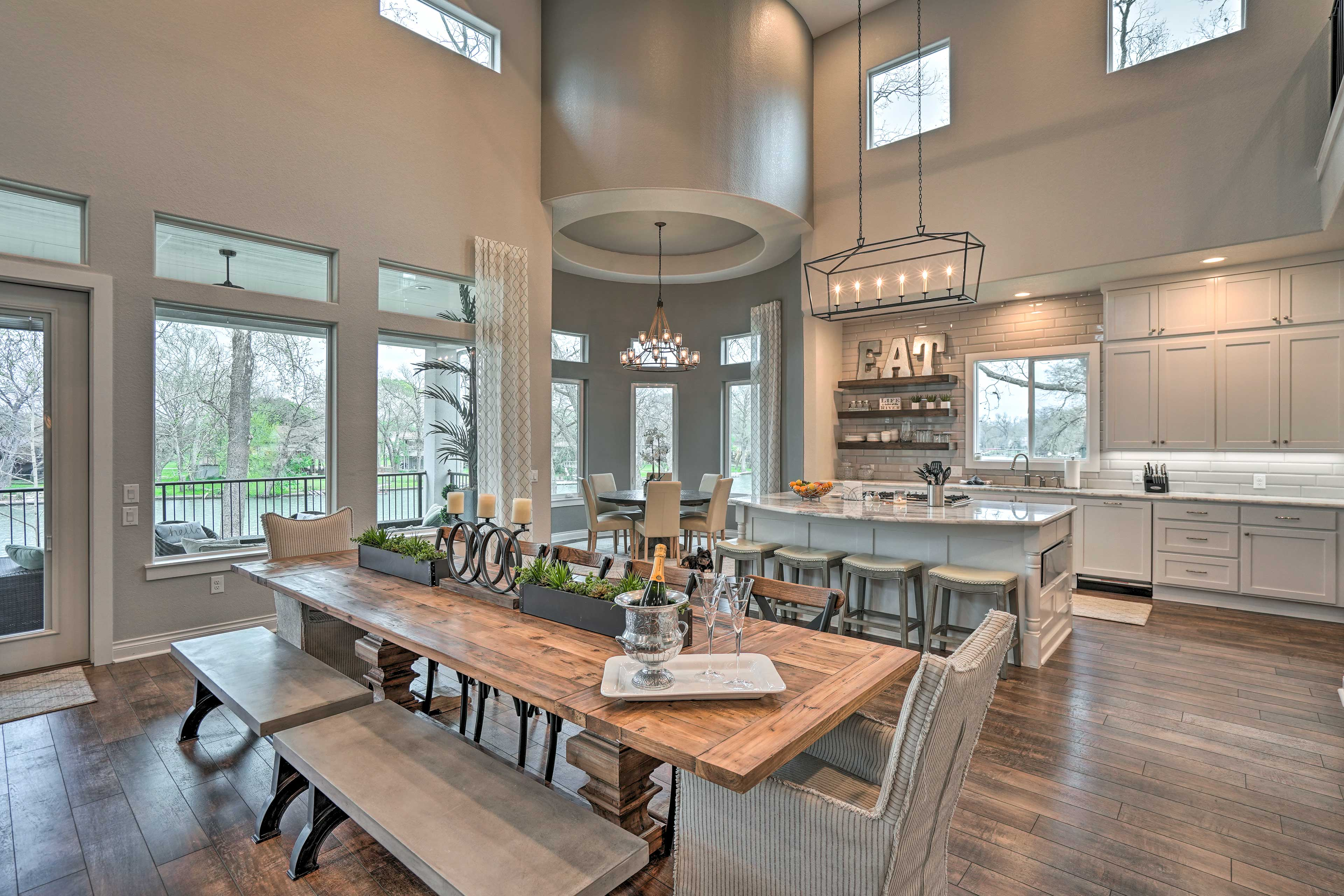 Gather around the large dining table to savor home-cooked meals.