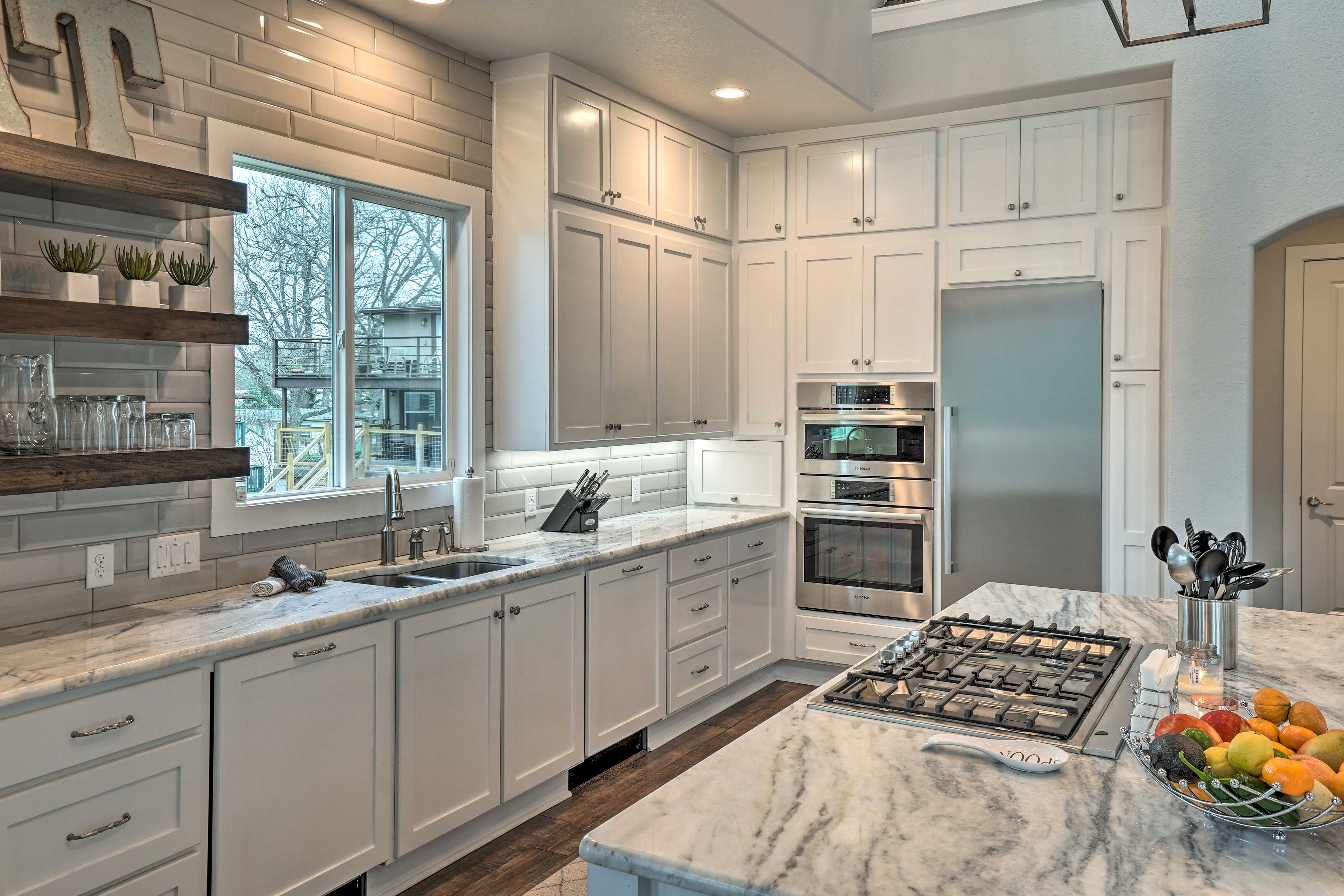 Utilize the stainless steel appliances in the fully equipped kitchen.