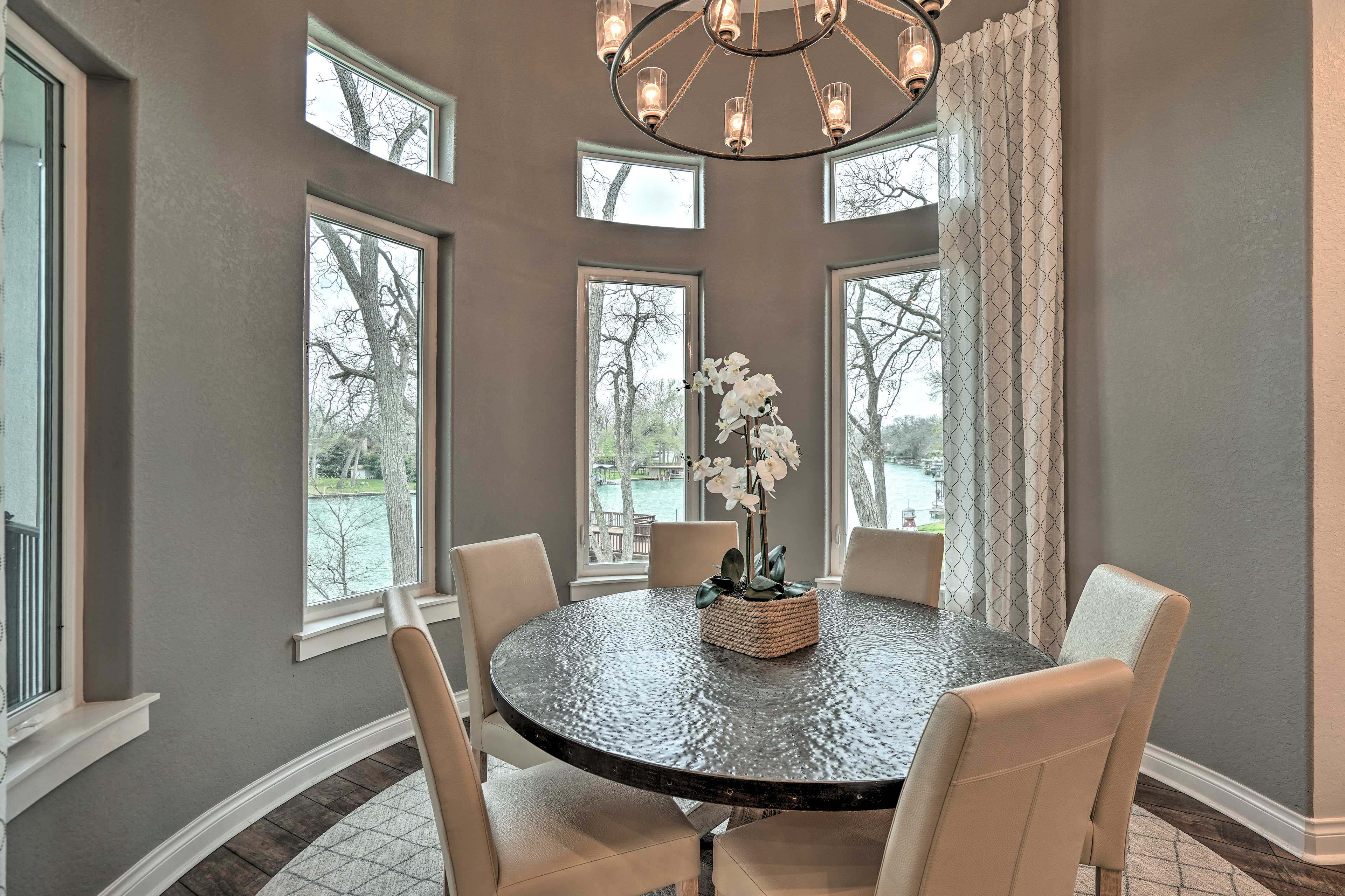 Savor breakfast in this kitchen nook with views of the water.