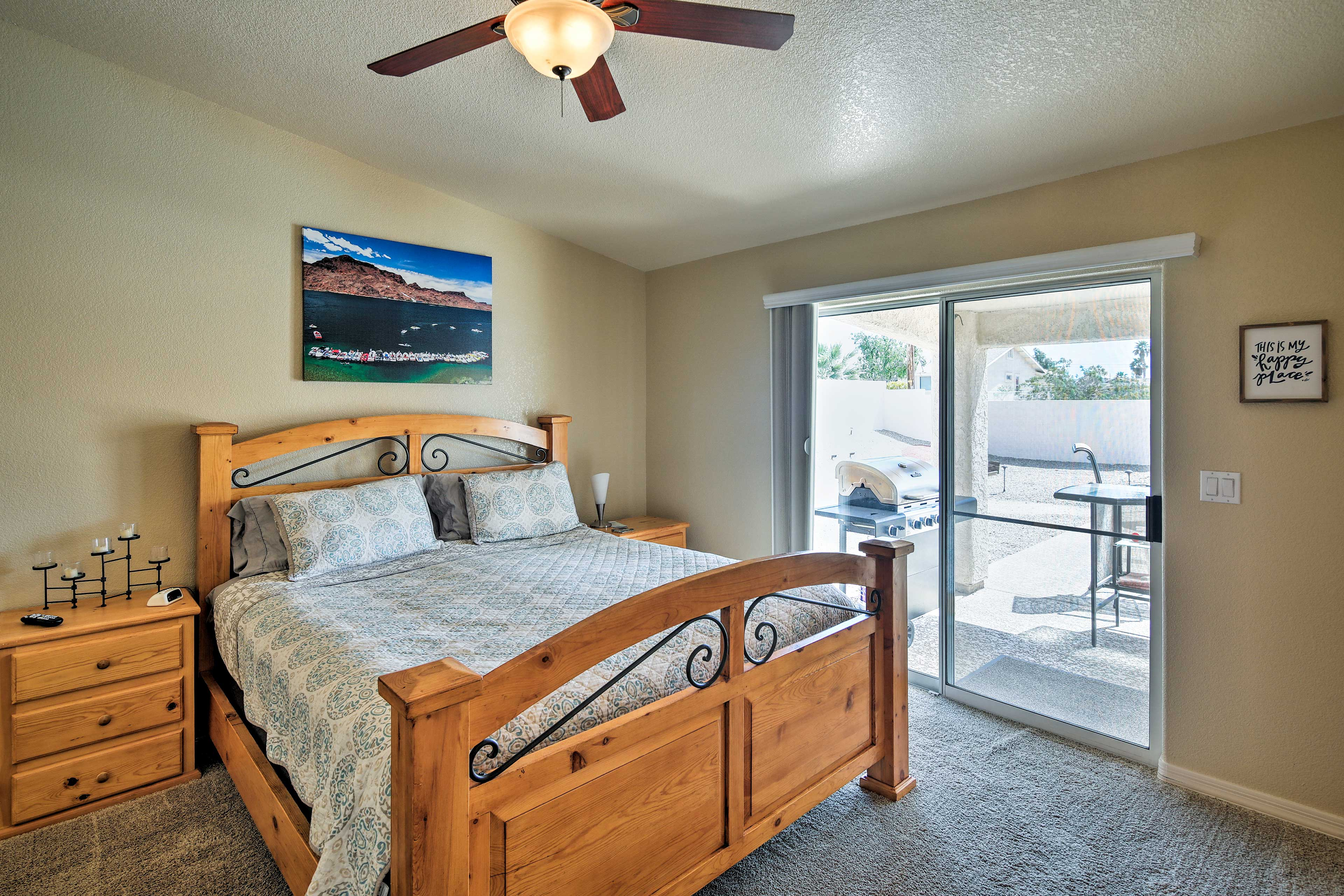 The master bedroom boasts a cozy king bed and private patio entrance.