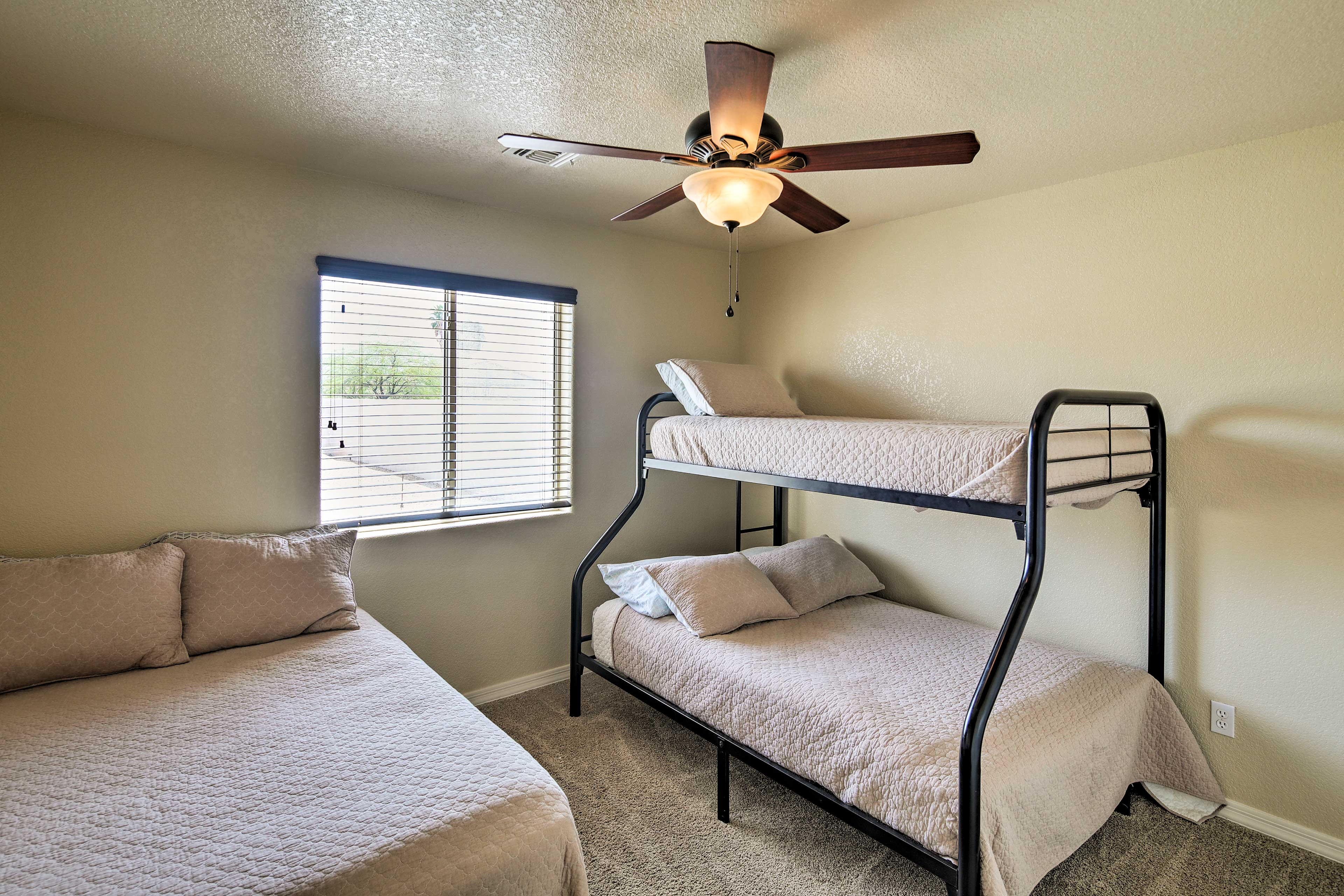 The 2nd bedroom features a twin-over-full bunk bed and full-sized bed.