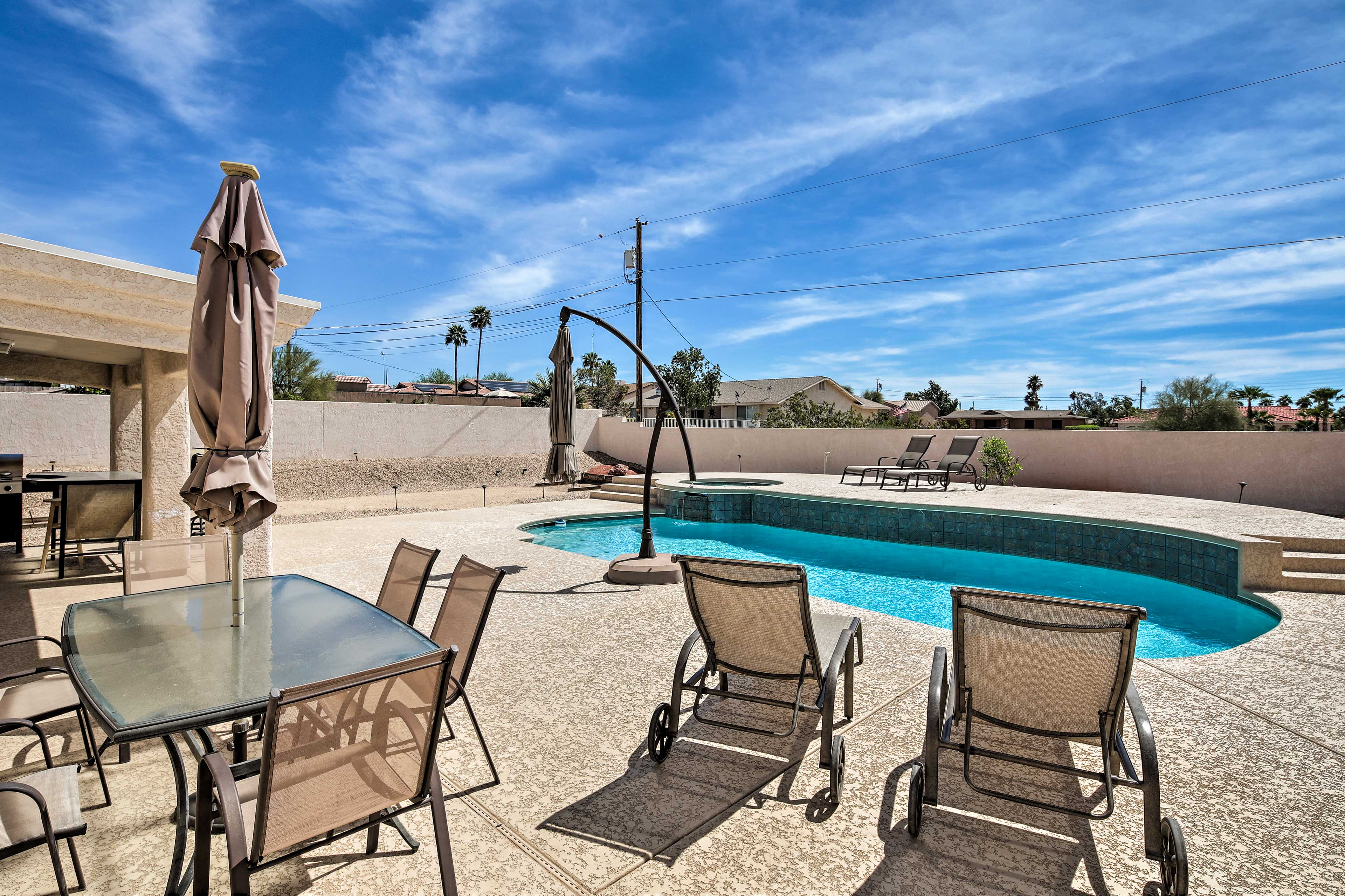 Catch some sun on patio lounge chairs, then jump in the pool to cool off!