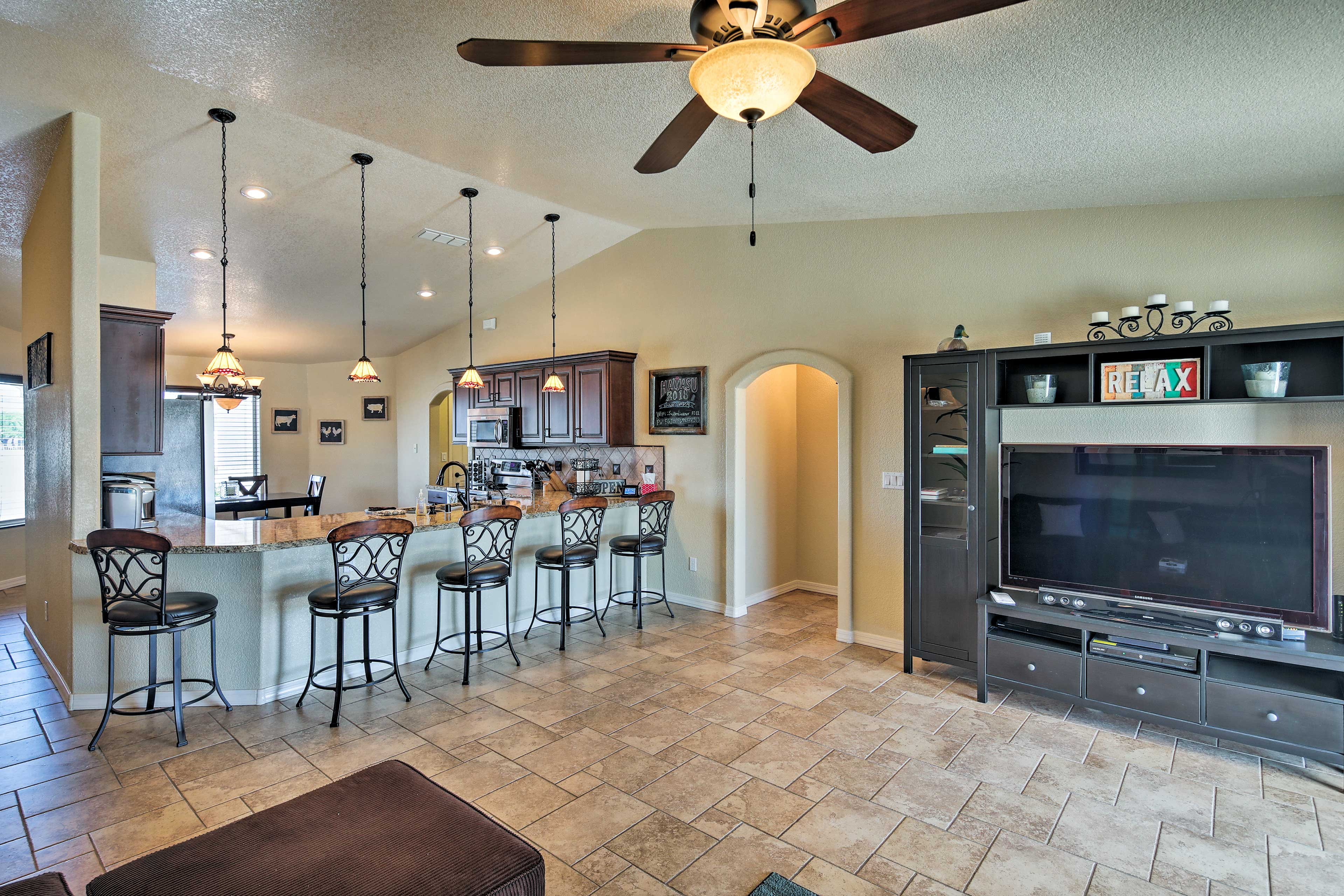 The open layout brings the living, dining, and kitchen areas together.