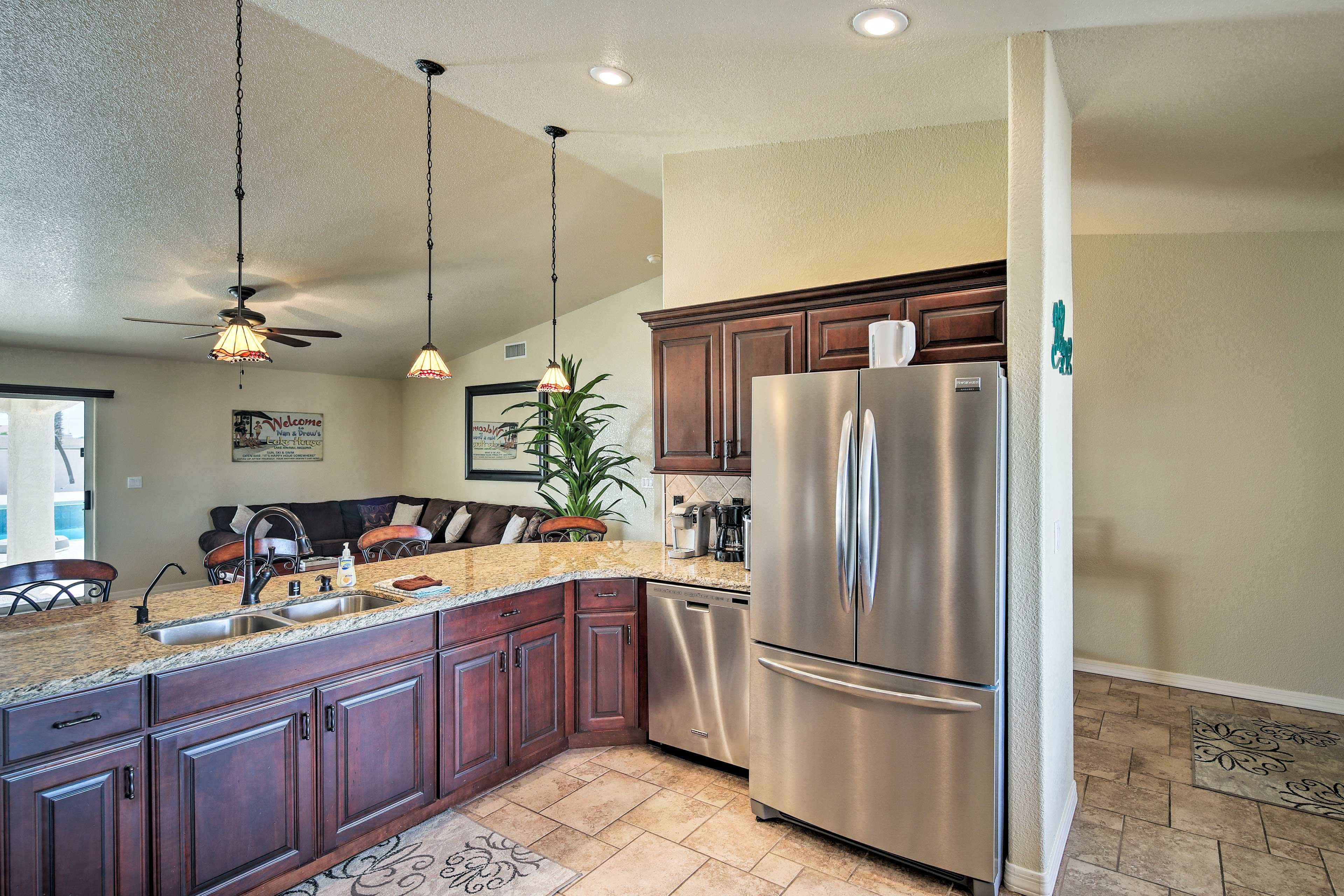 The kitchen is fully equipped with state-of-the-art stainless steel appliances.