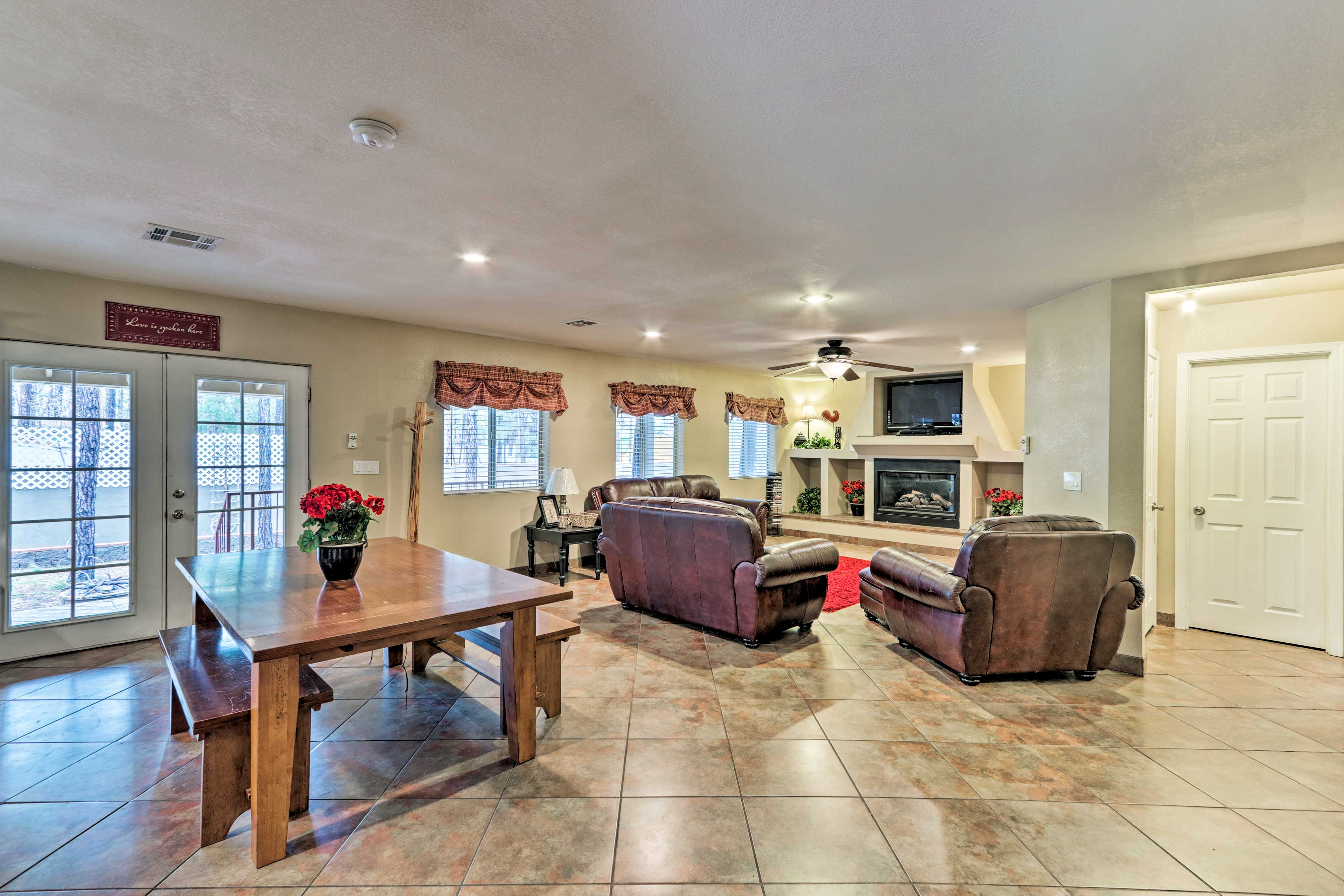The open concept living area boasts deck access through the French doors.