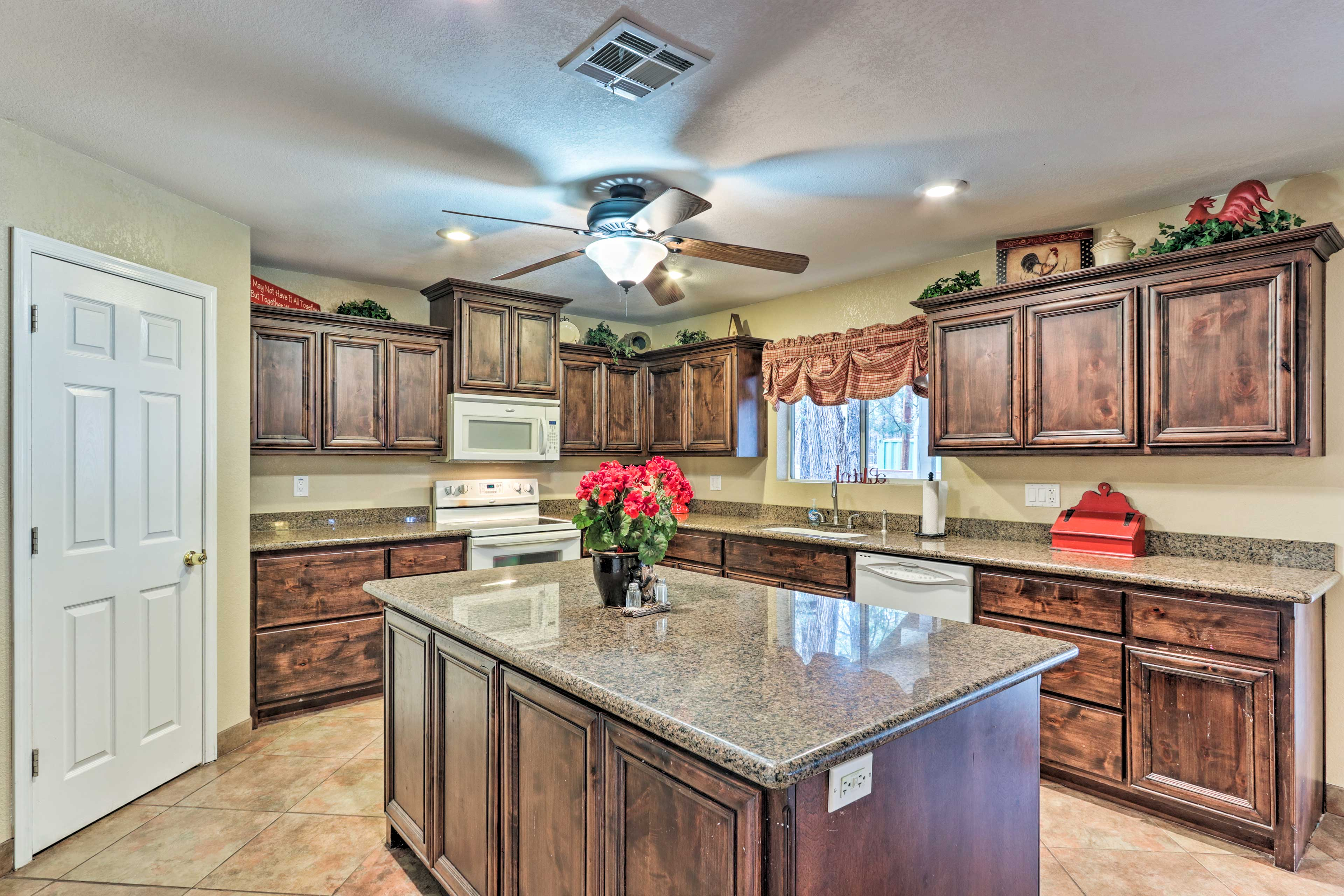 The fully equipped kitchen boasts wraparound counters and an island.