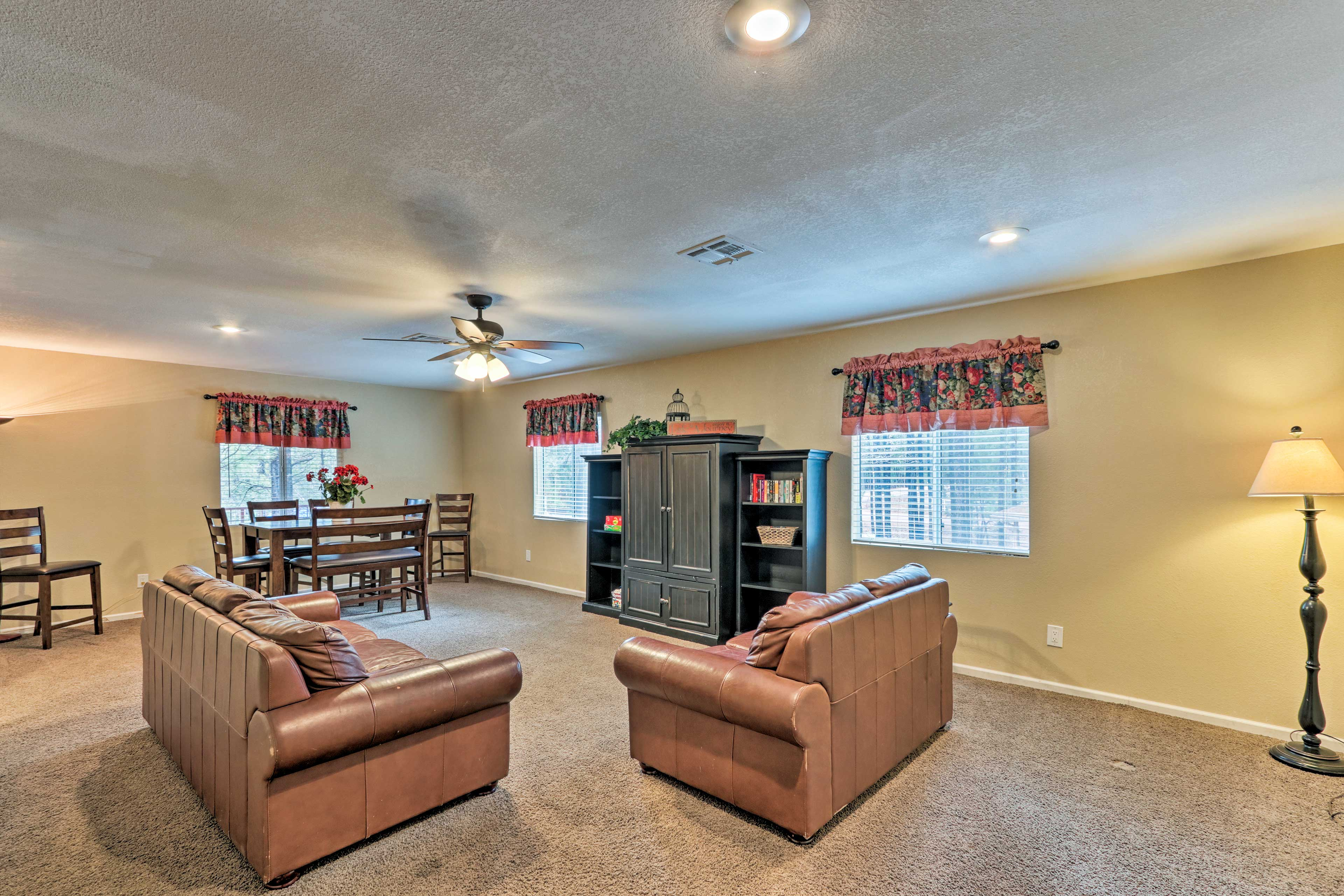 This downstairs space also features another seating and dining area.