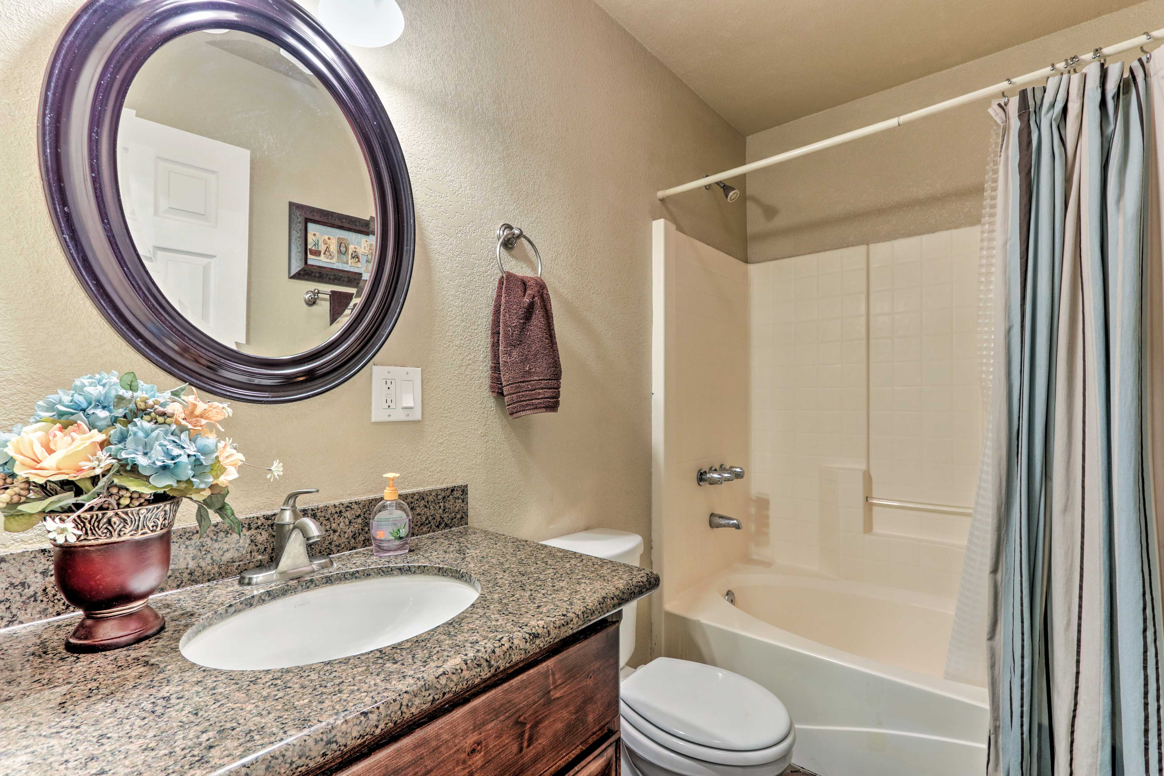 Soft provided towels complete this full bathroom.