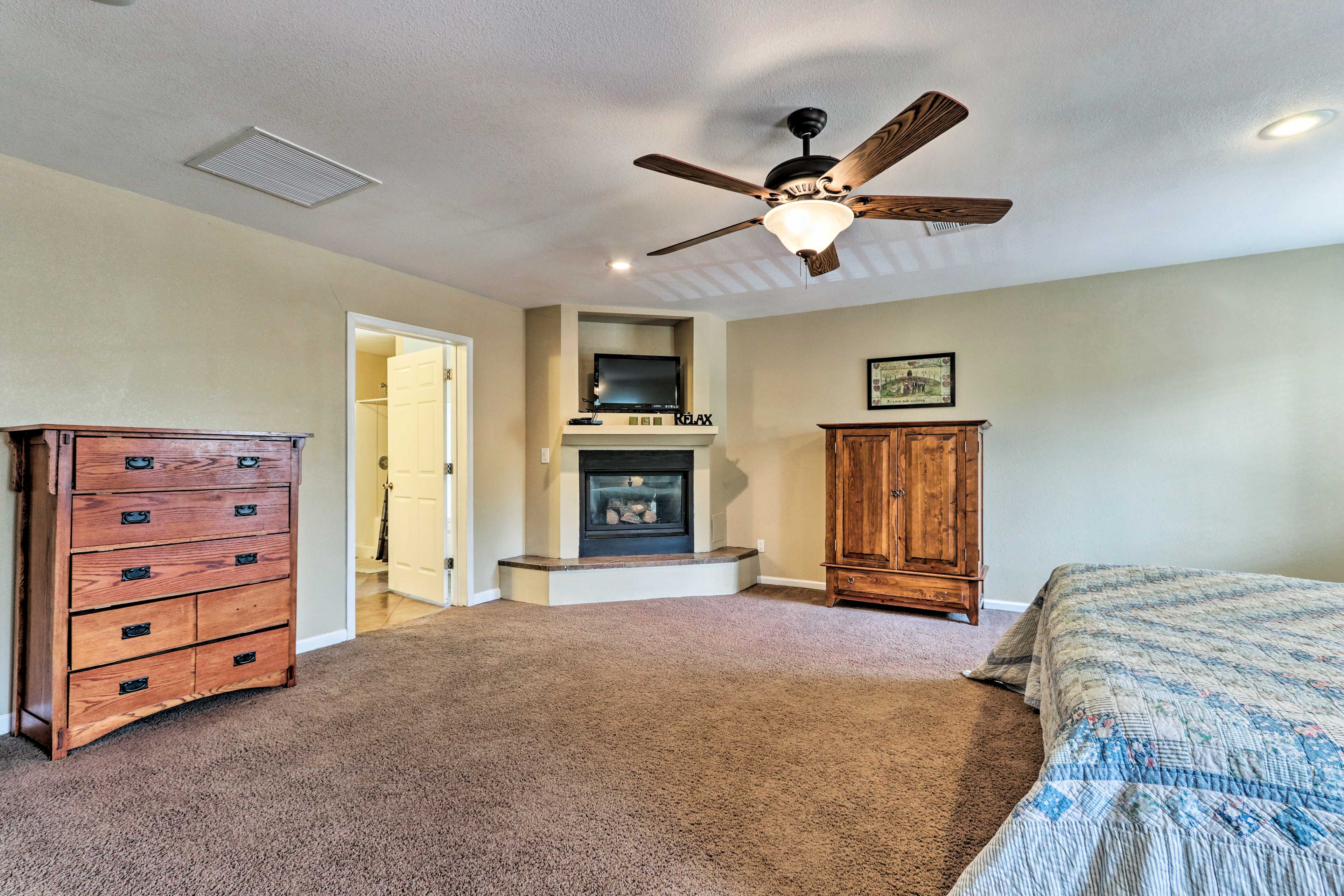 The bedroom hosts a king bed, flat-screen TV and a gas fireplace.
