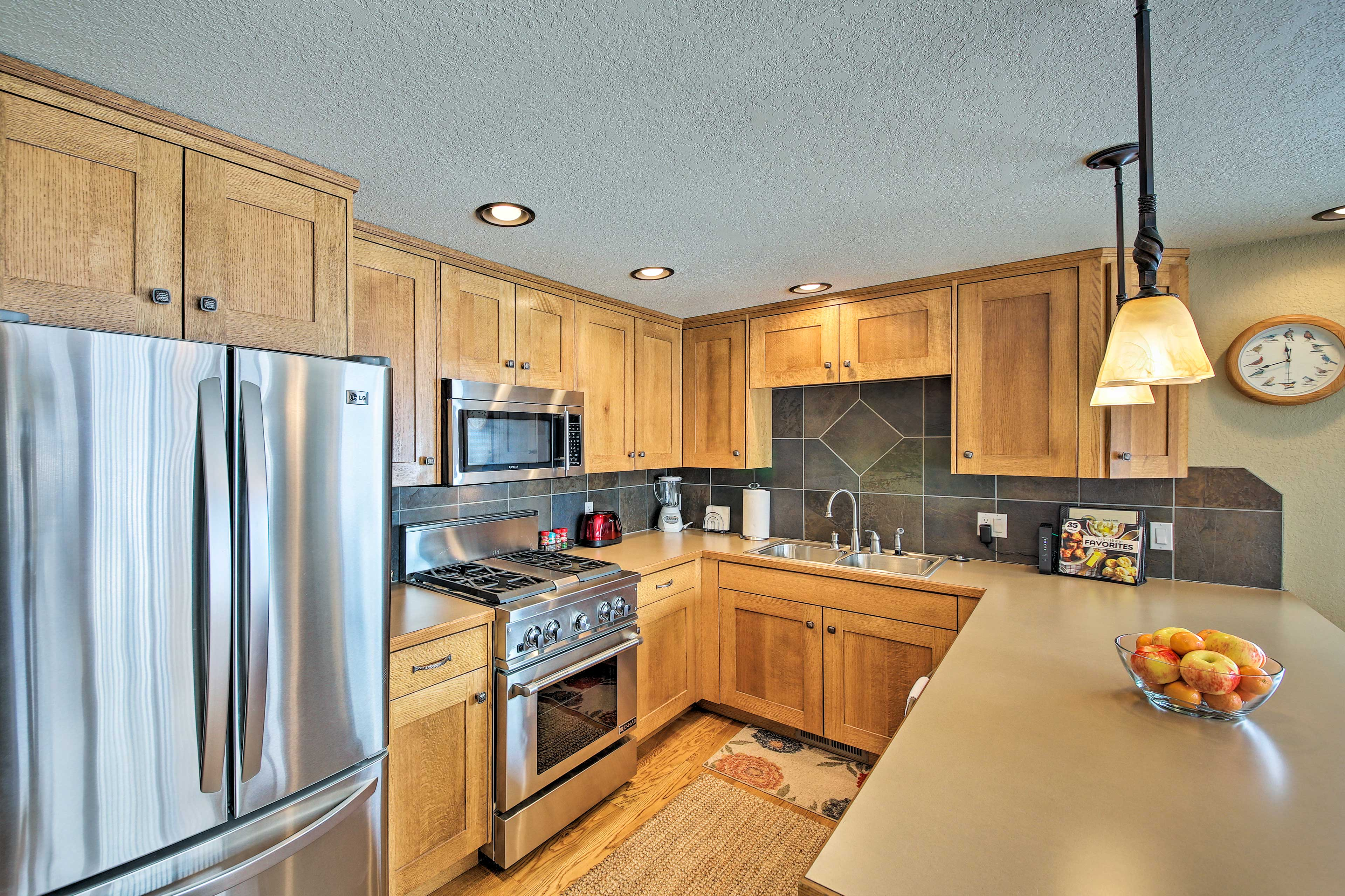 The kitchen is outfitted with stainless steel appliances.