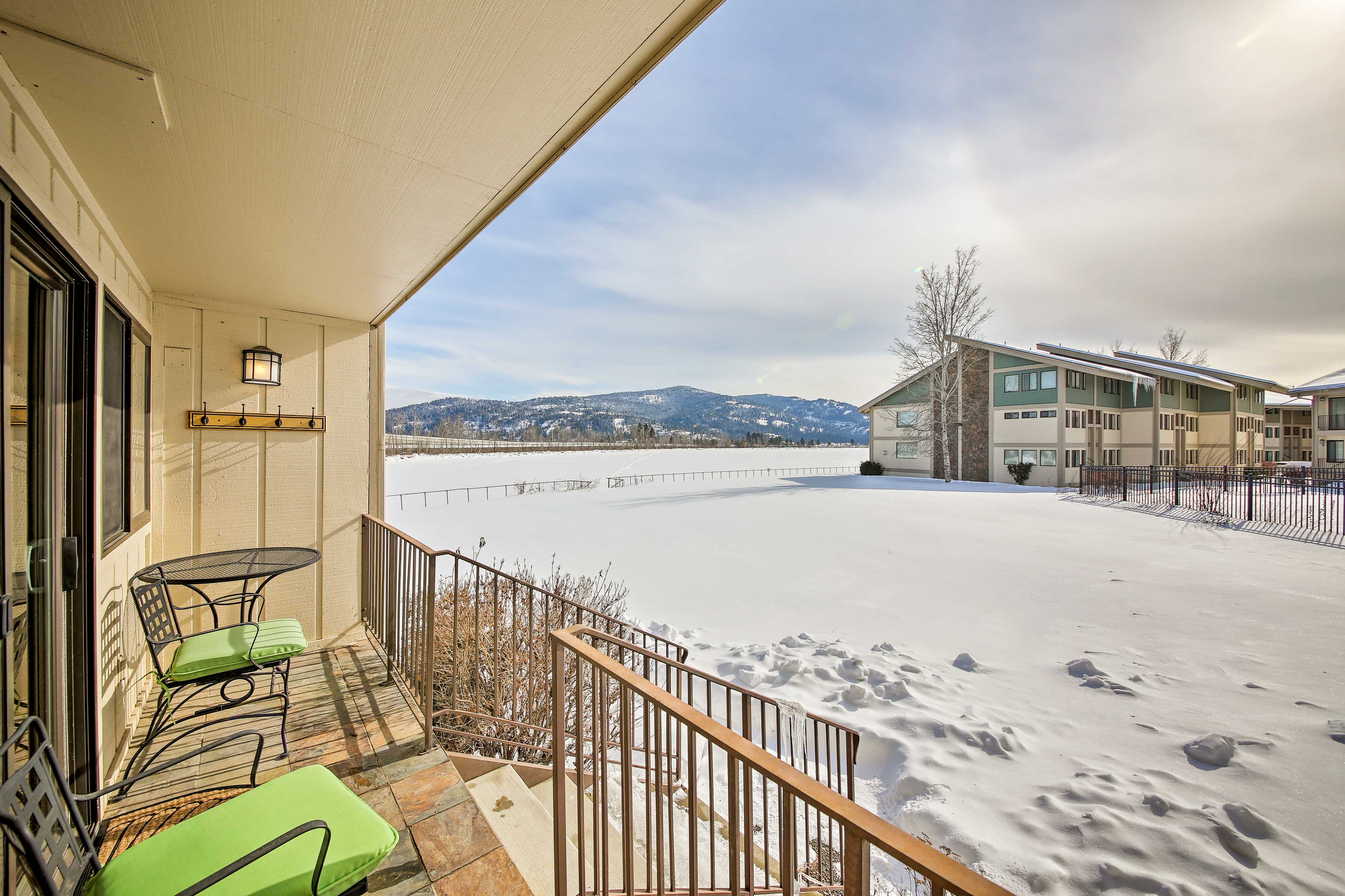 The condo provides a porch with outdoor seating and mountain views.