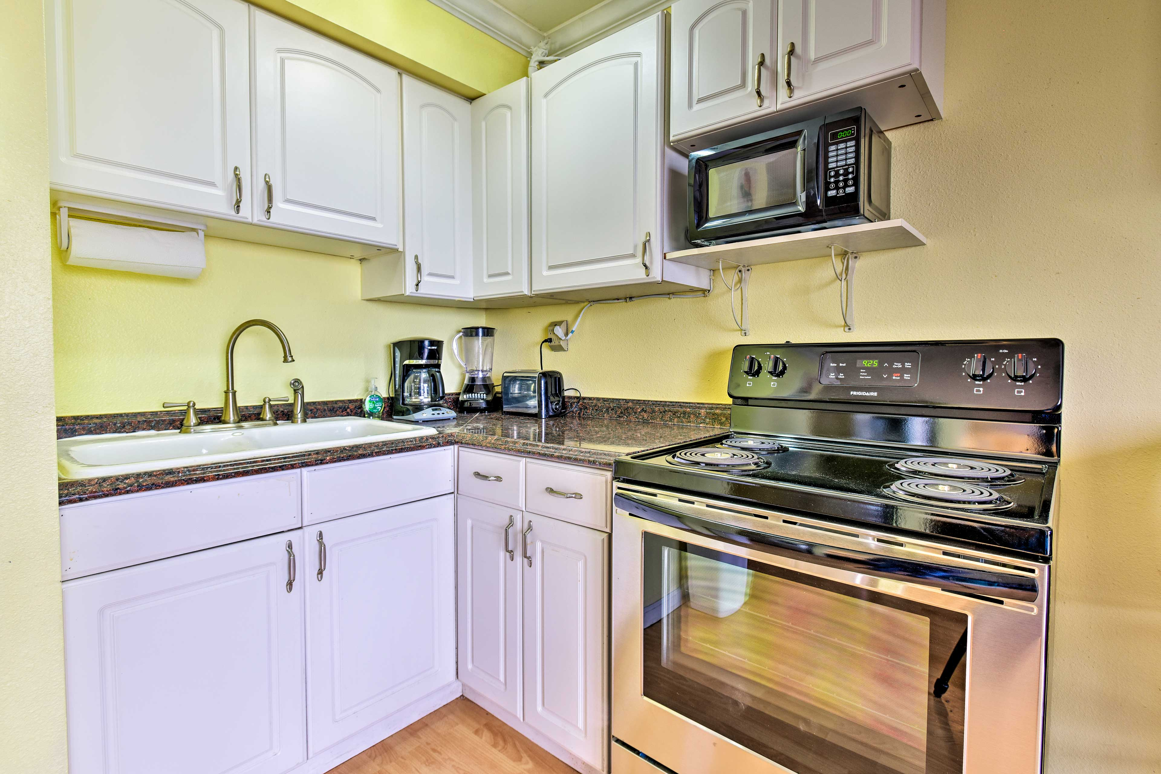 The kitchen features up-to-date appliances and plenty of space to cook.