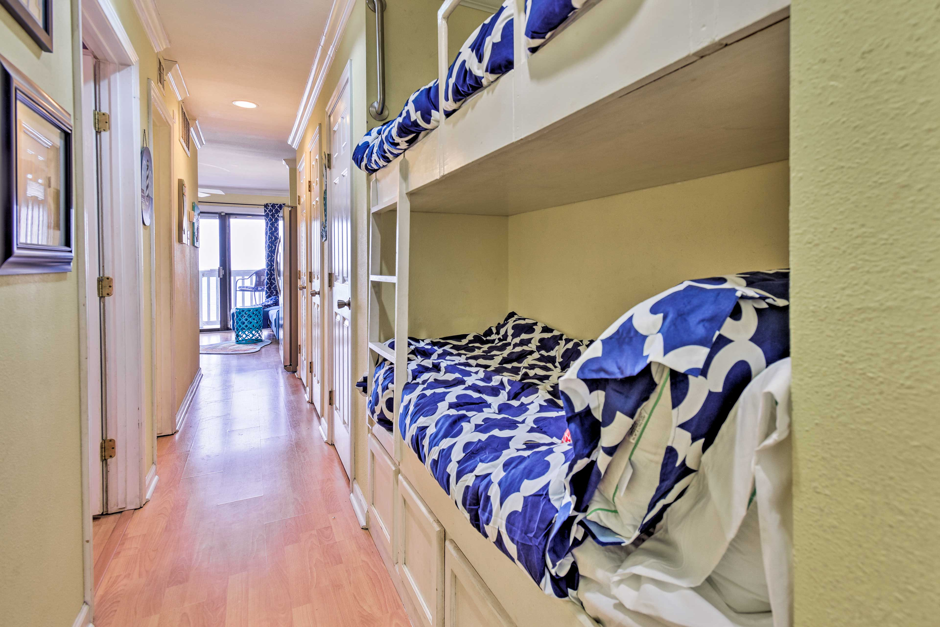 The hallway is equipped with a built-in bunk bed.