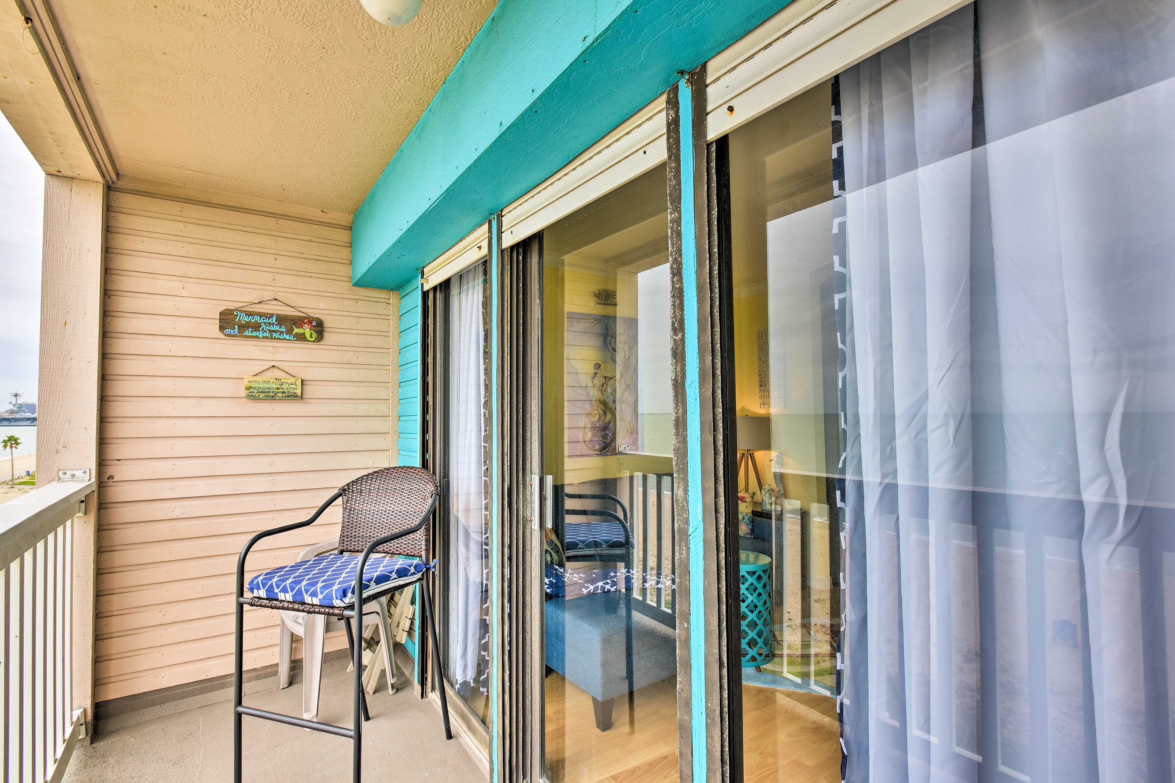 Open the sliding glass doors and walk out to the private balcony!