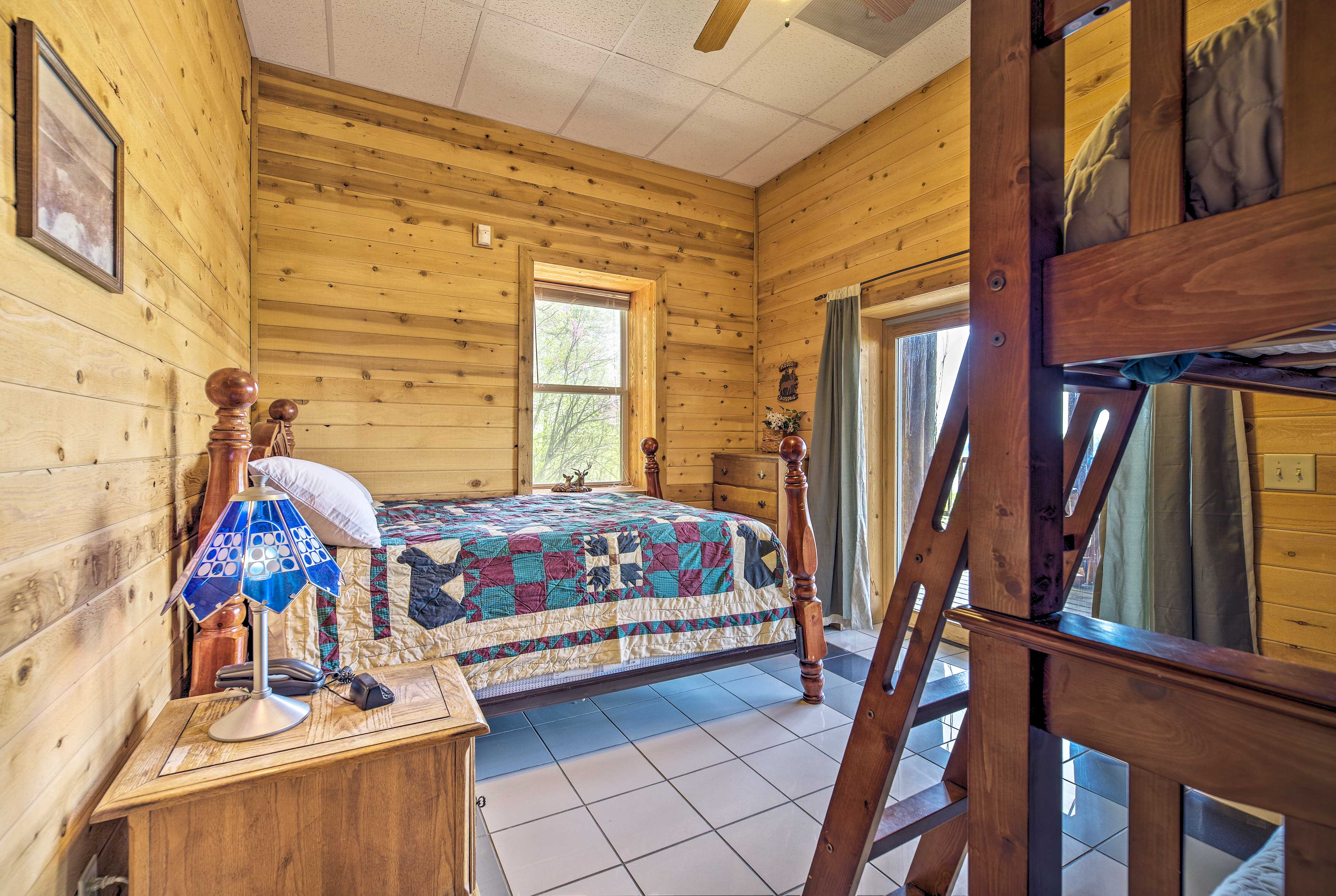 Hop in the queen bed or twin bunk bed in this room.
