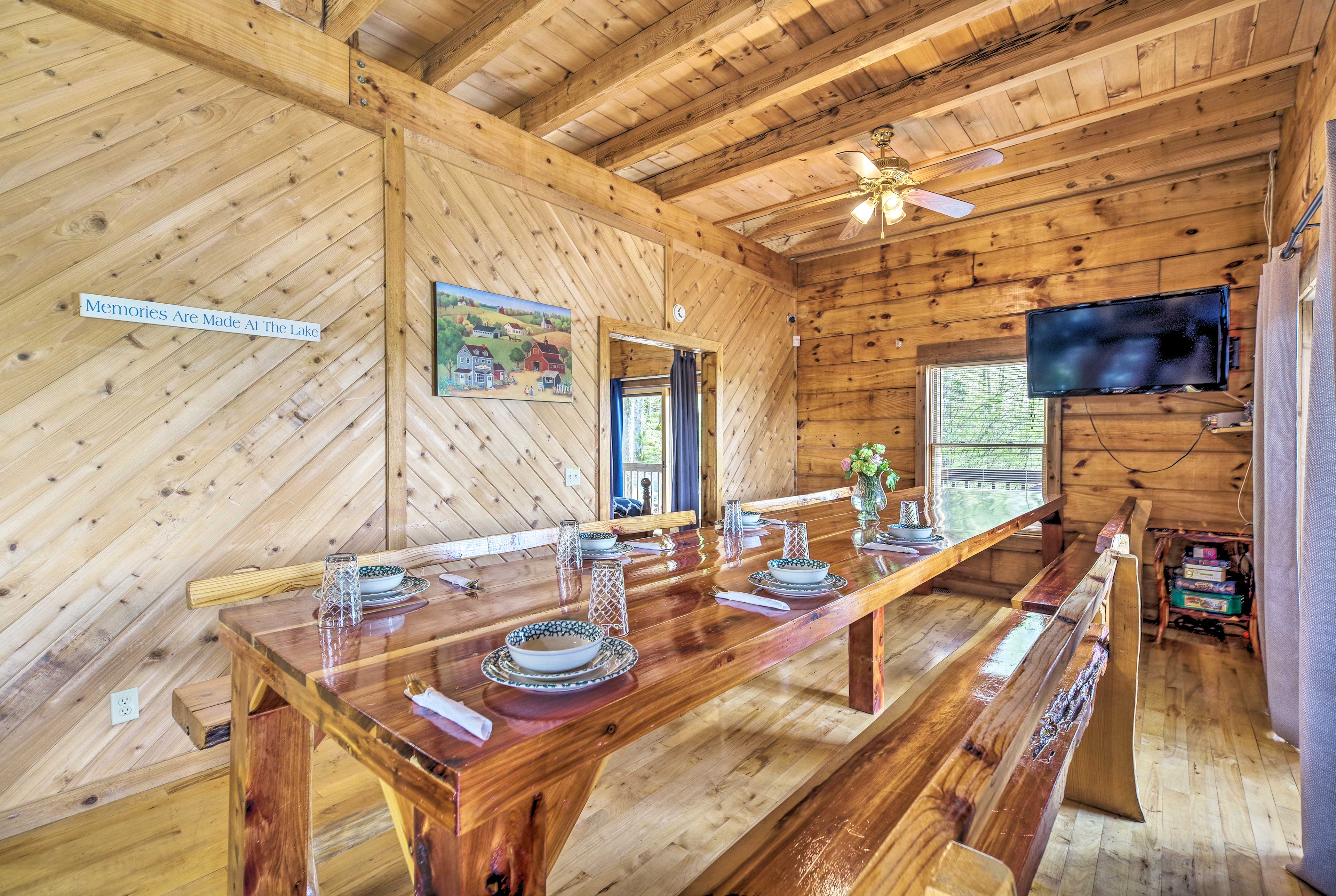 Gather around the large dining table to enjoy family feasts.