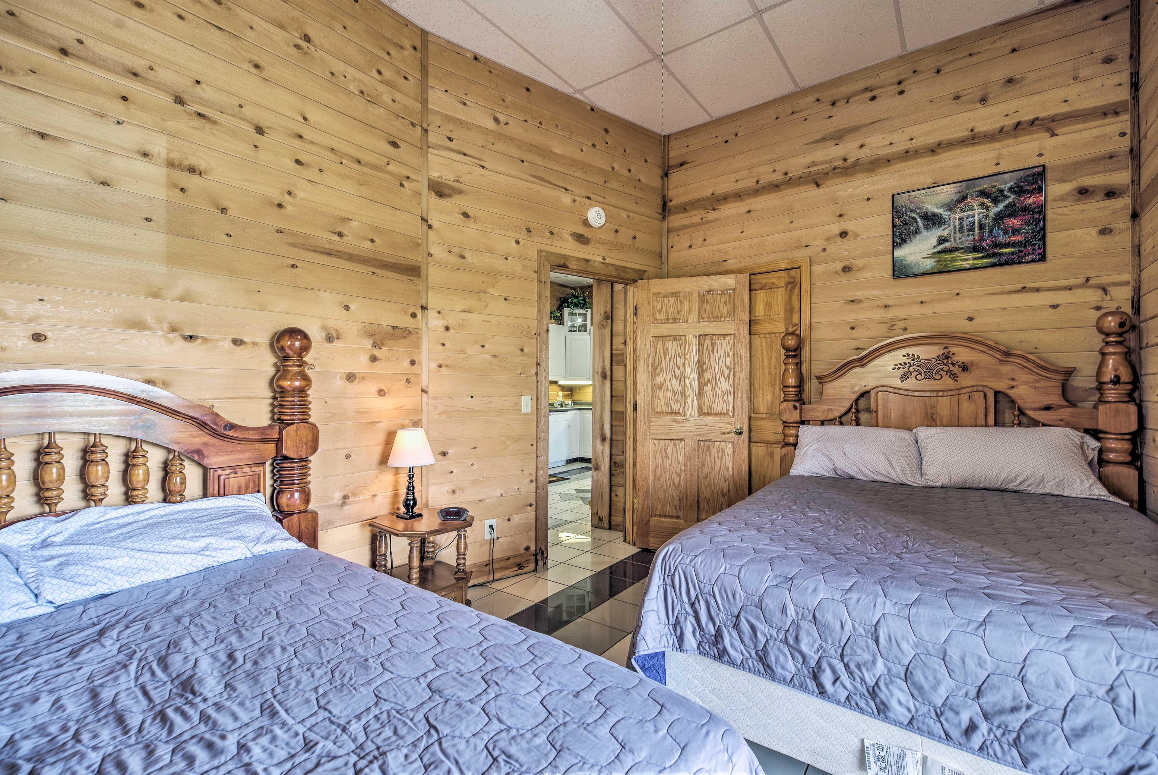 This bedroom features 2 queen beds.