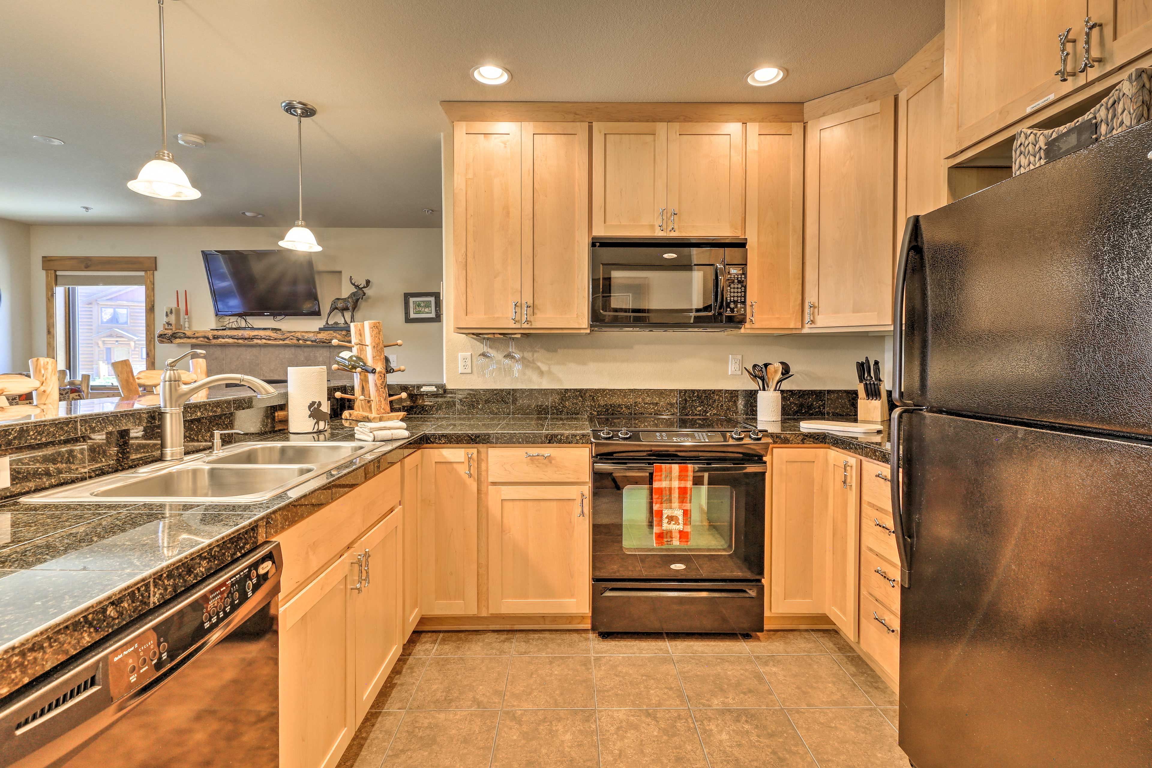 The kitchen comes fully equipped with granite counters.