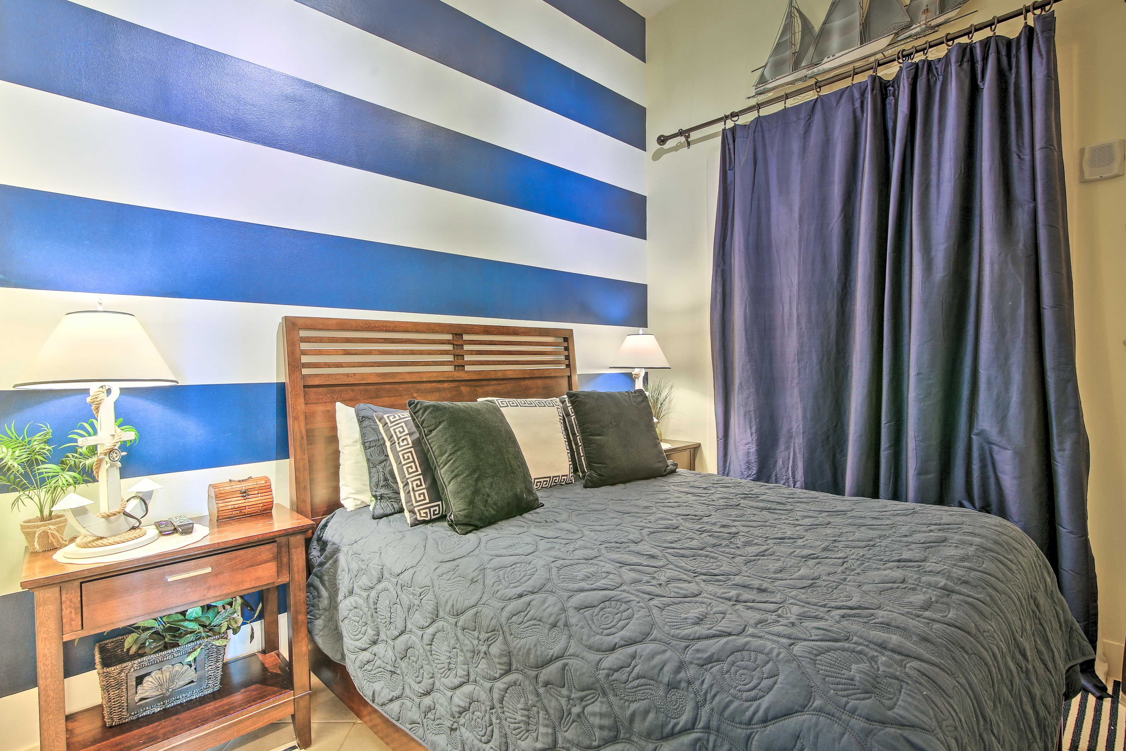 Welcome yourself into bedroom three with a queen size bed.