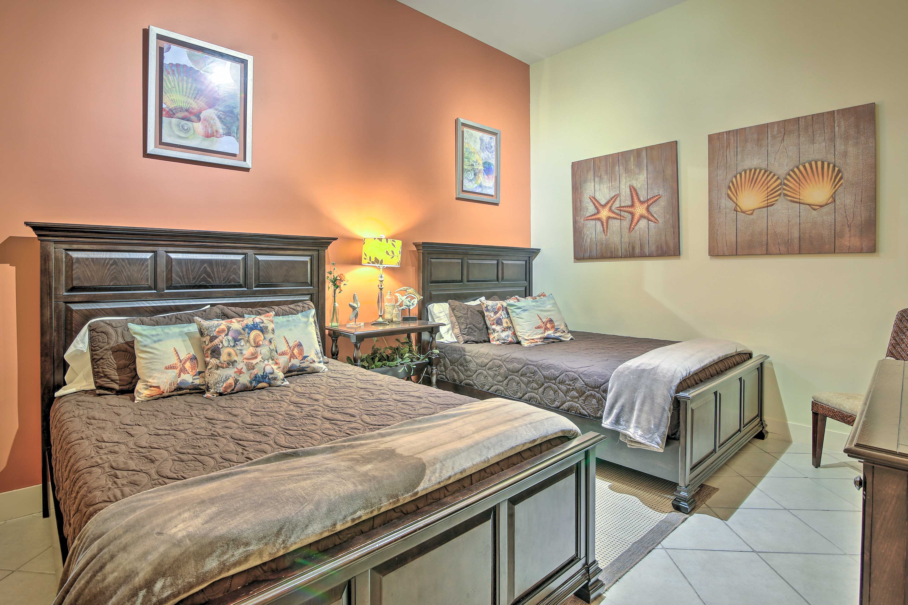 Take your pick of one of two queen beds in this bedroom.