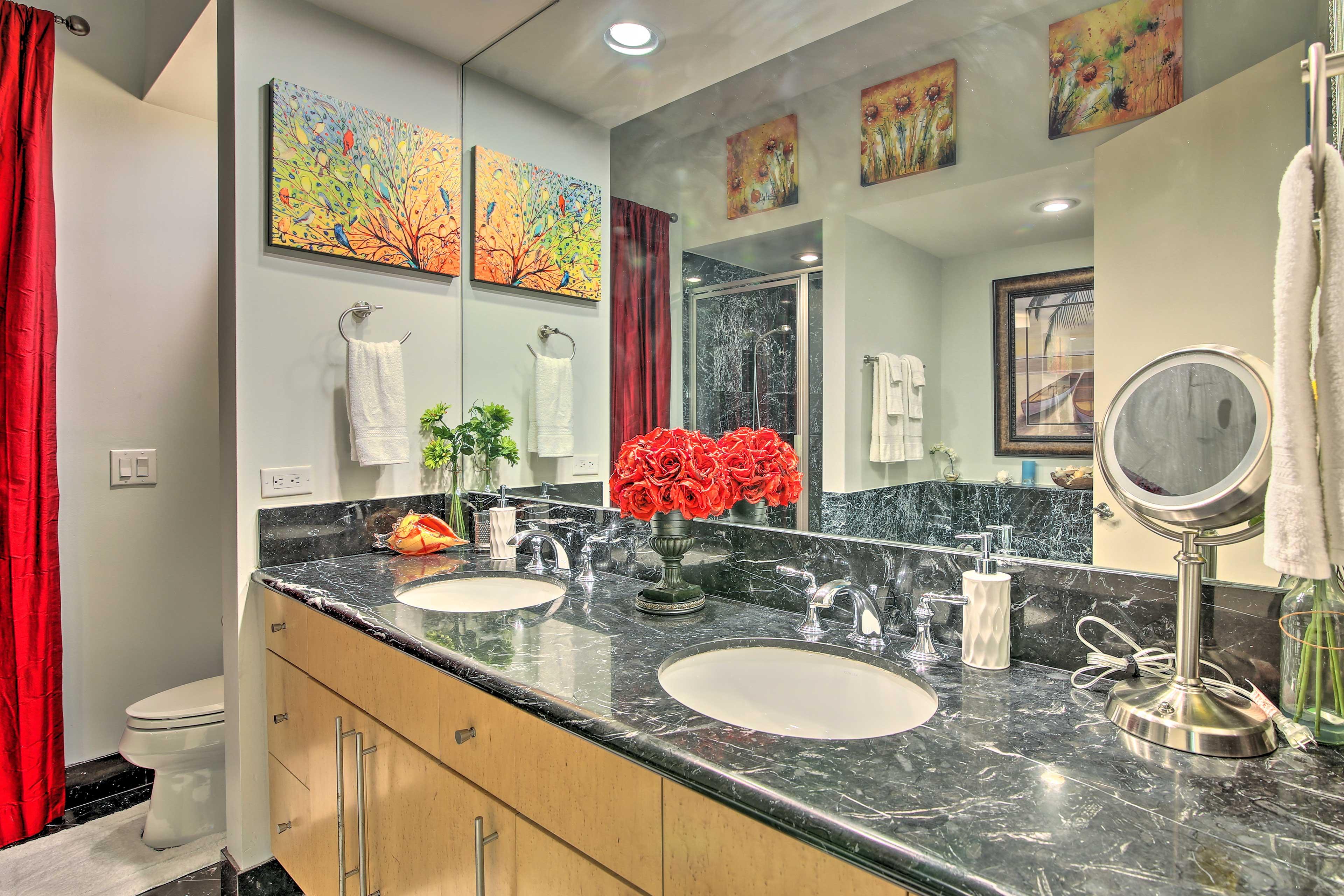 Appreciate dual sinks in the master's en-suite bathroom to easily get ready.