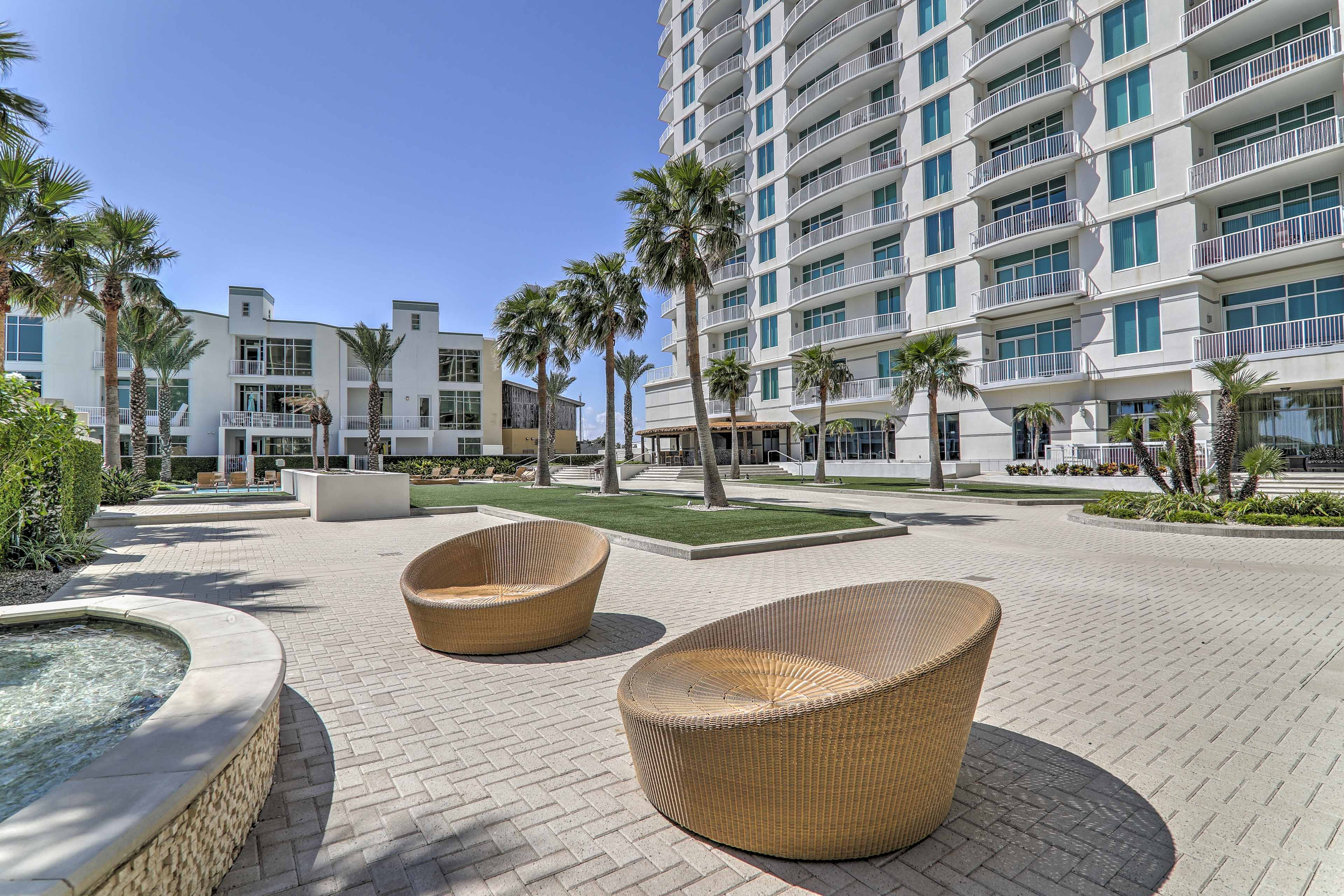 Step outside to find a beautiful plaza with chairs and water features.