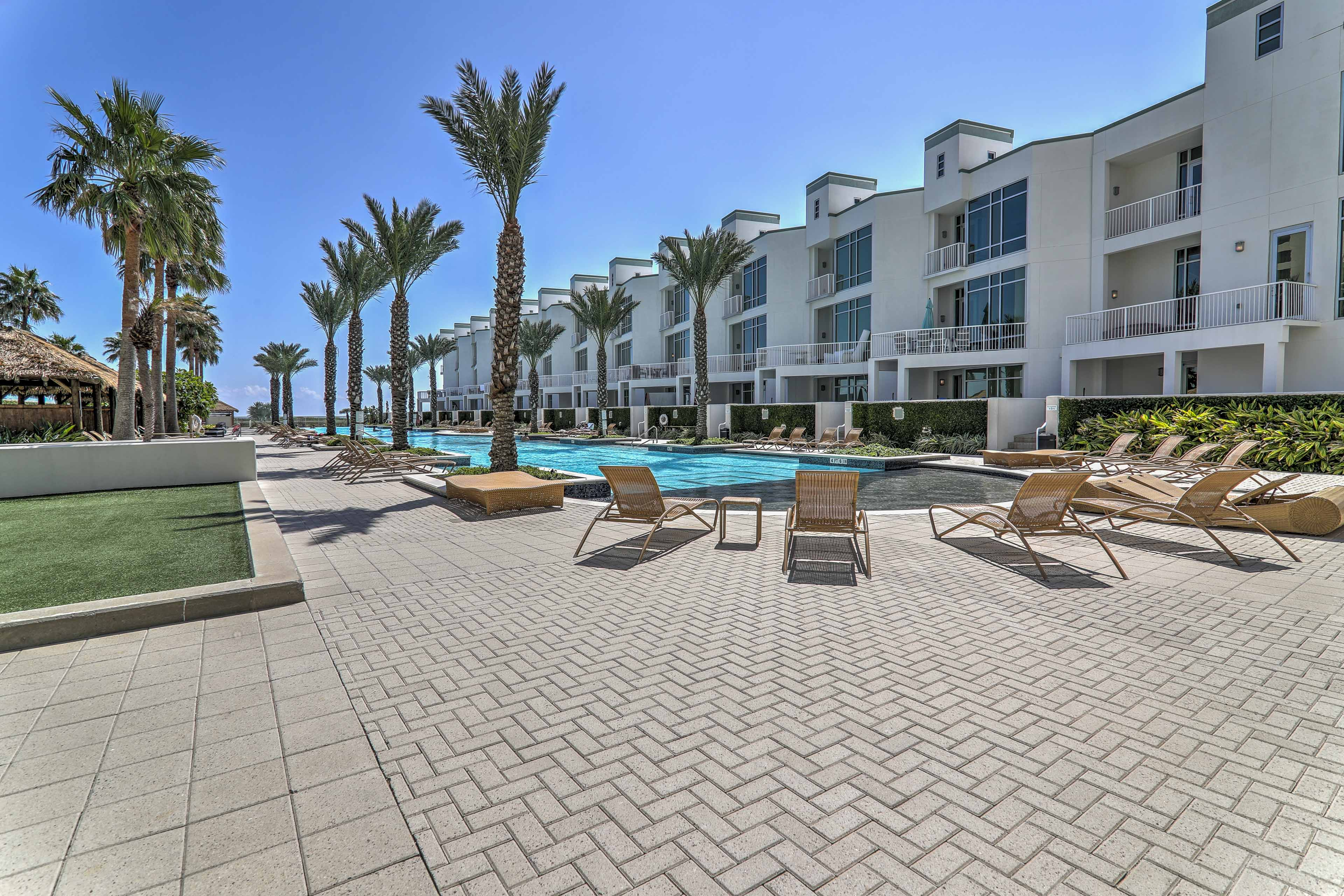 Snap a picture of your poolside moment by the cabanas with the breeze blowing.