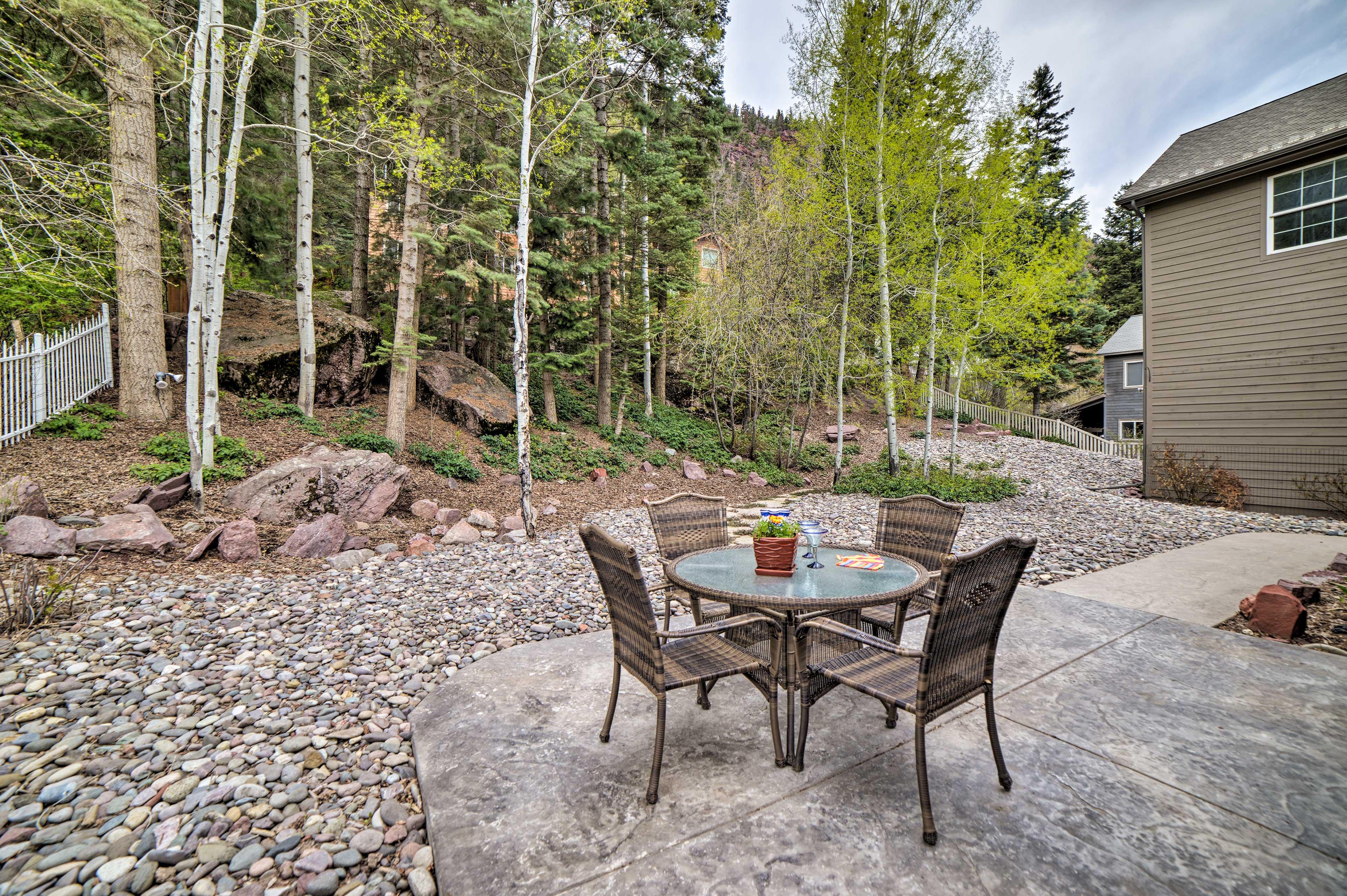 An aspen grove frames the private backyard.