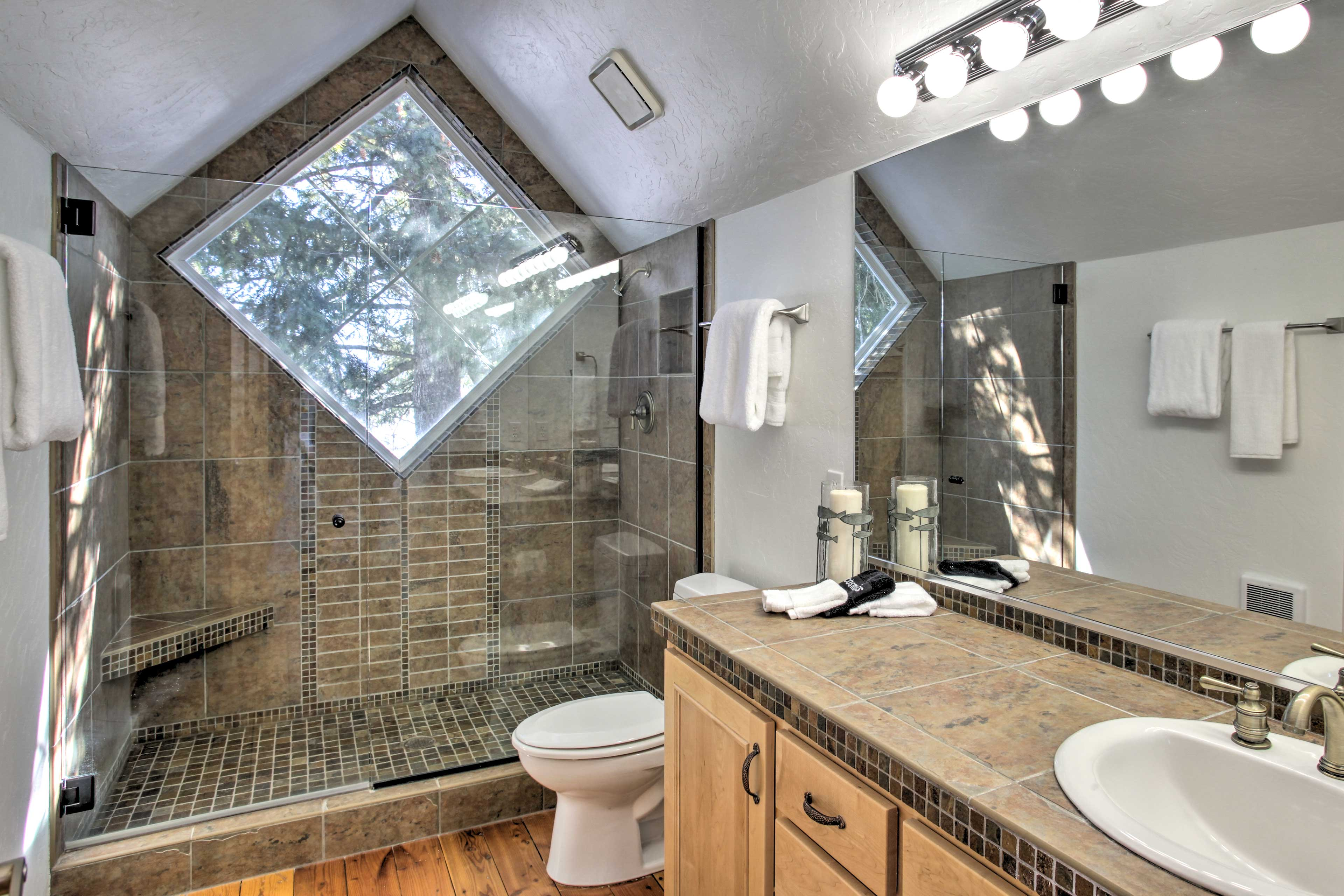 This full en-suite bathroom features a spacious walk-in shower.