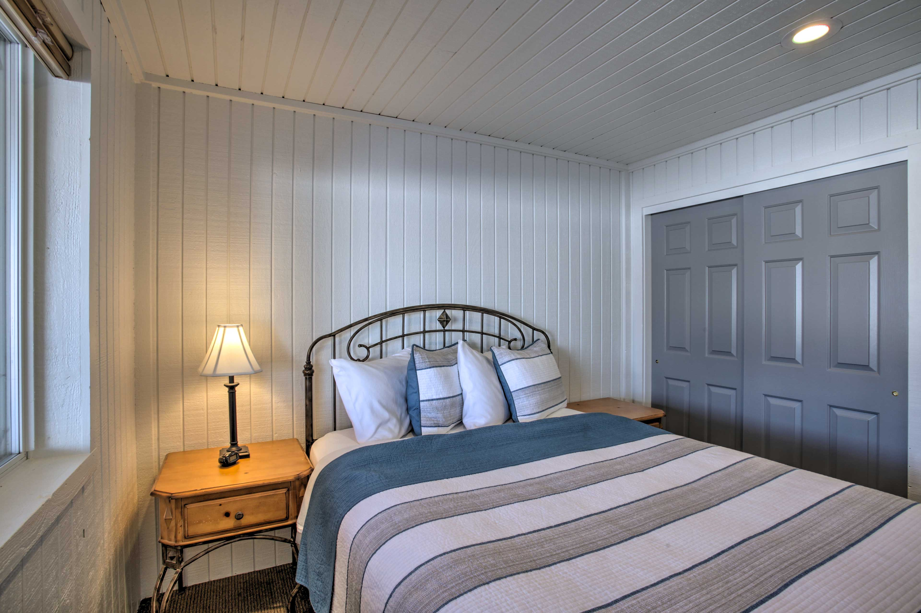 This next bedroom houses a queen-sized bed.
