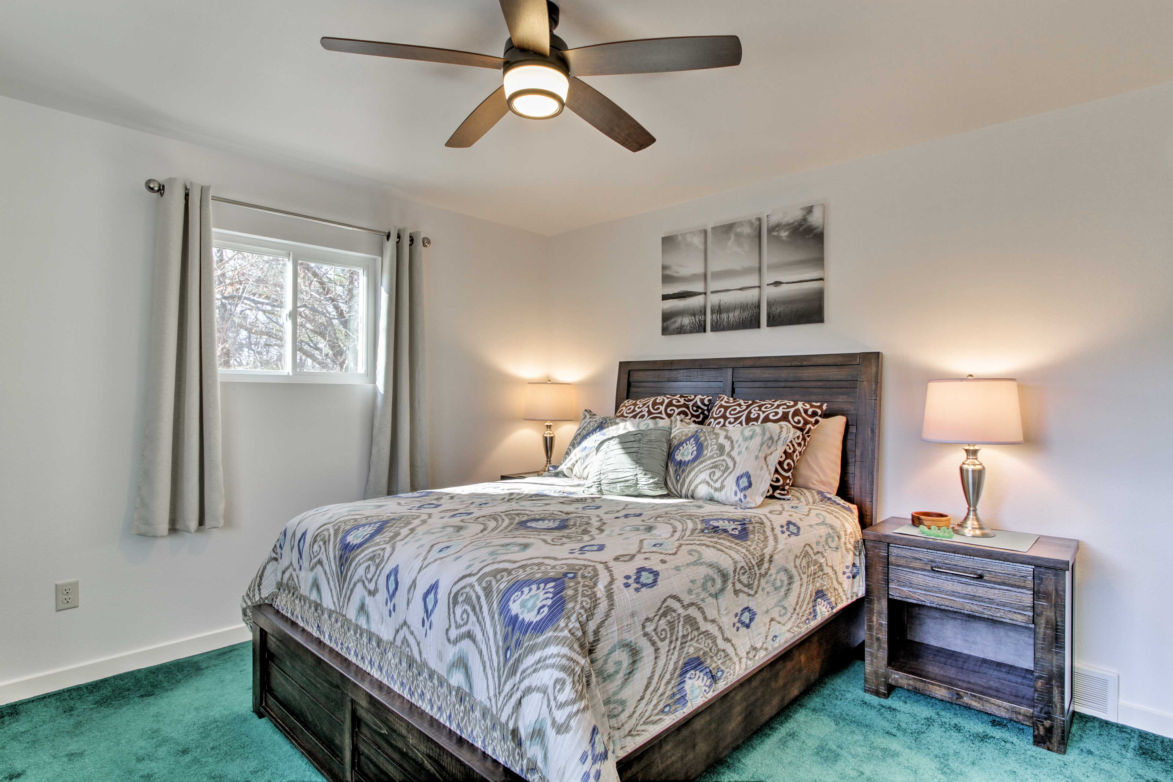 Two guests can share the comfort of this full-sized bed.