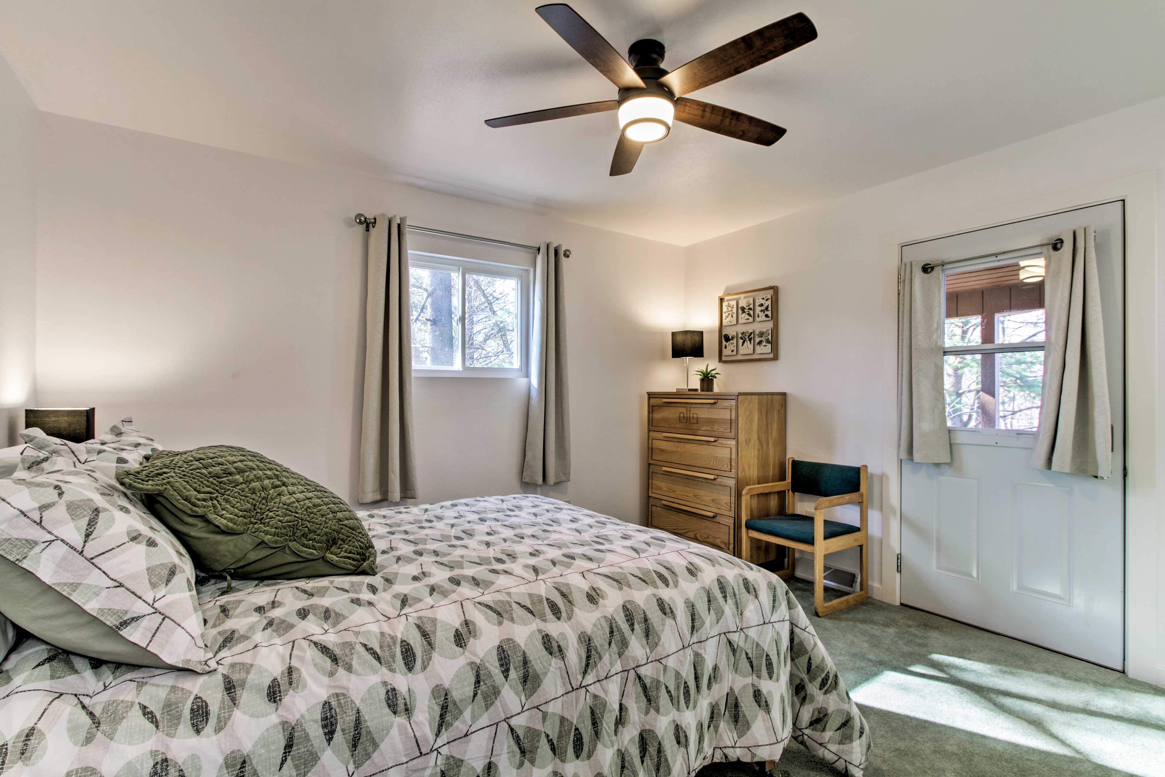 The master bedroom includes a queen-sized bed.