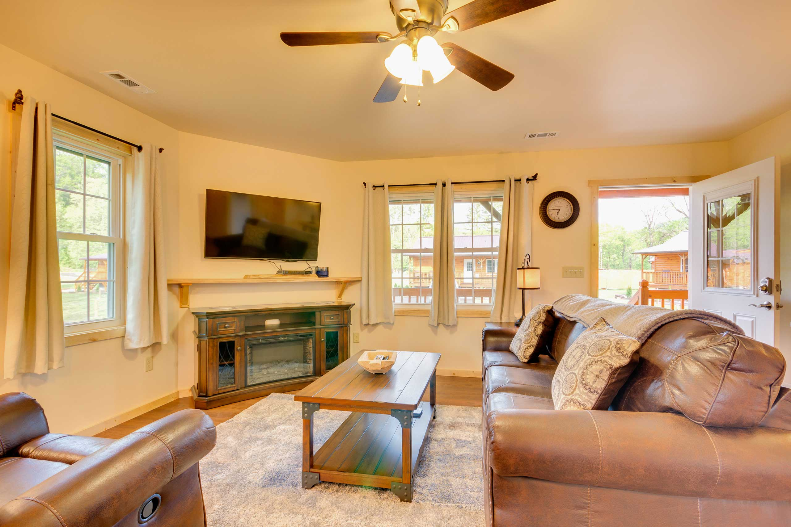 The open living space features wooden accents.
