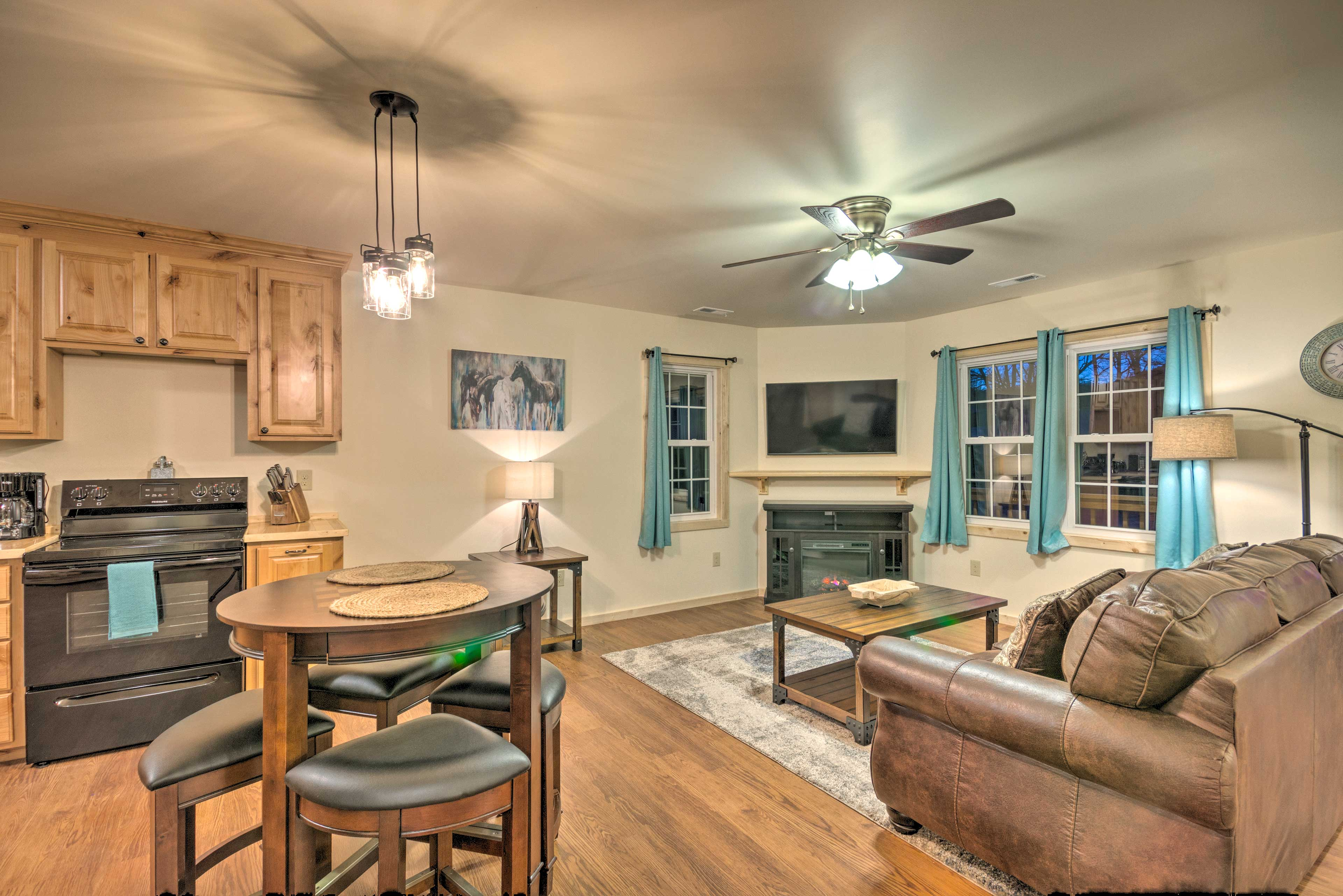 The living room seamlessly opens to the well-equipped kitchen.