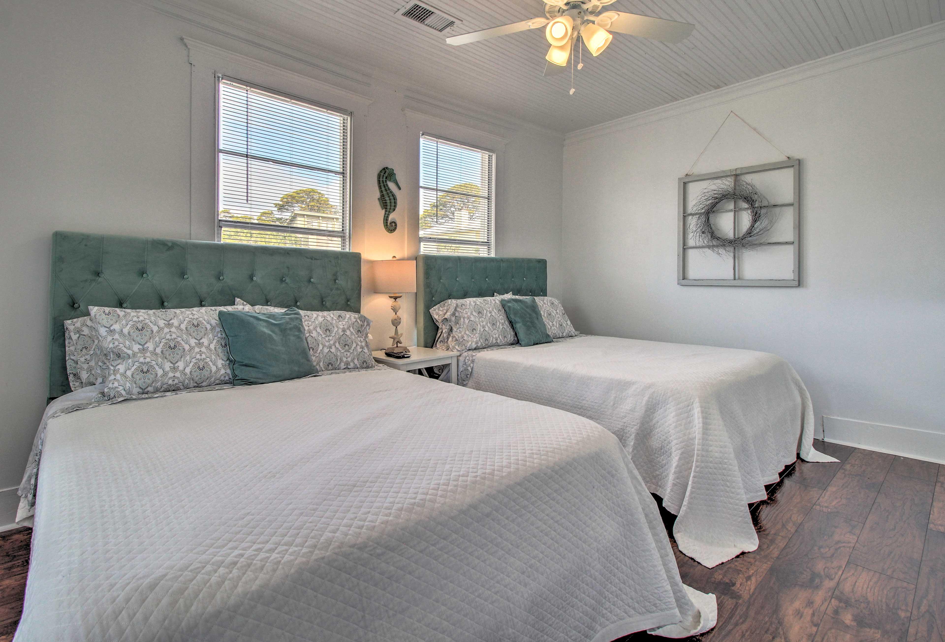 The second bedroom features 2 queen beds.