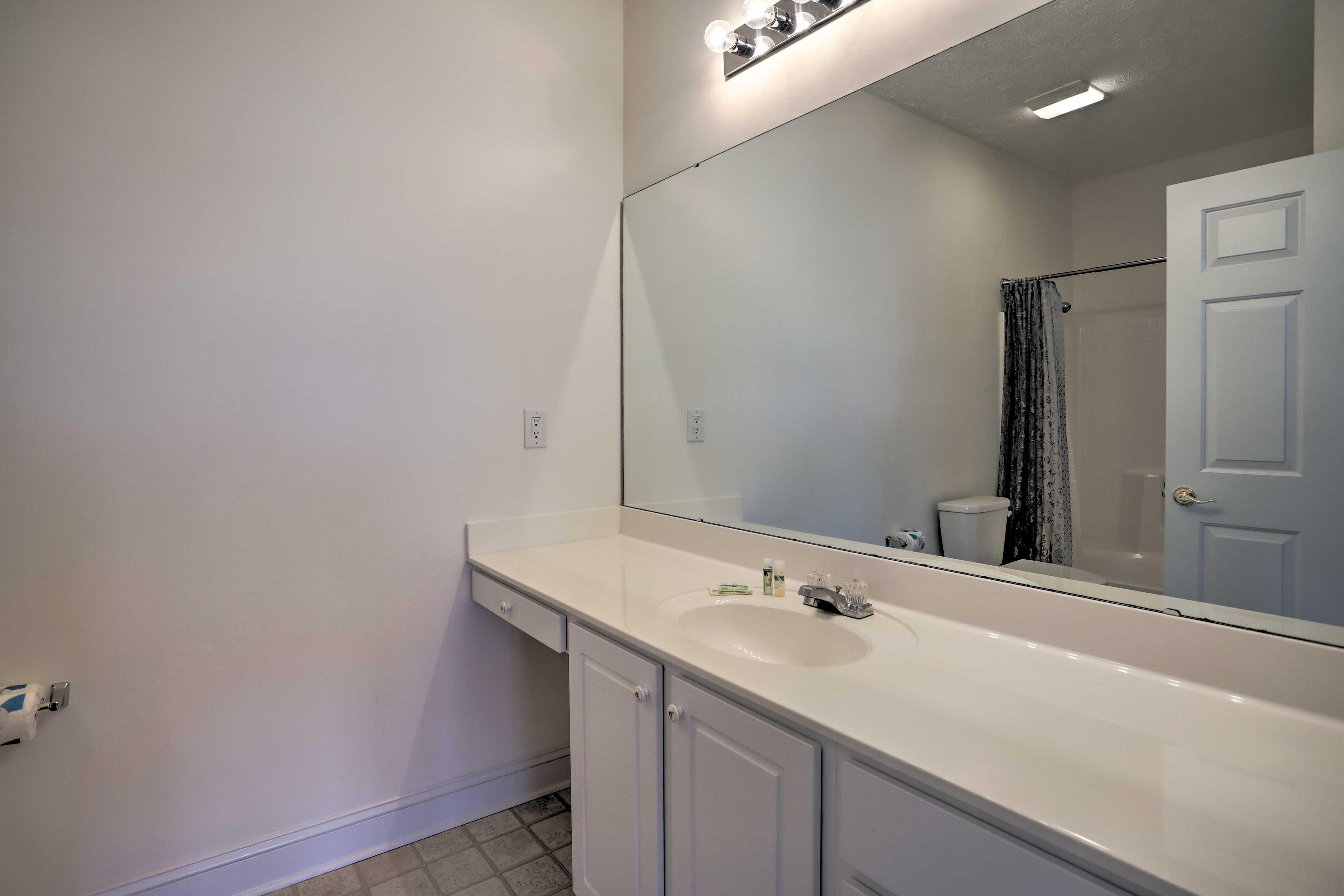 The en-suite bathroom has a spacious vanity.