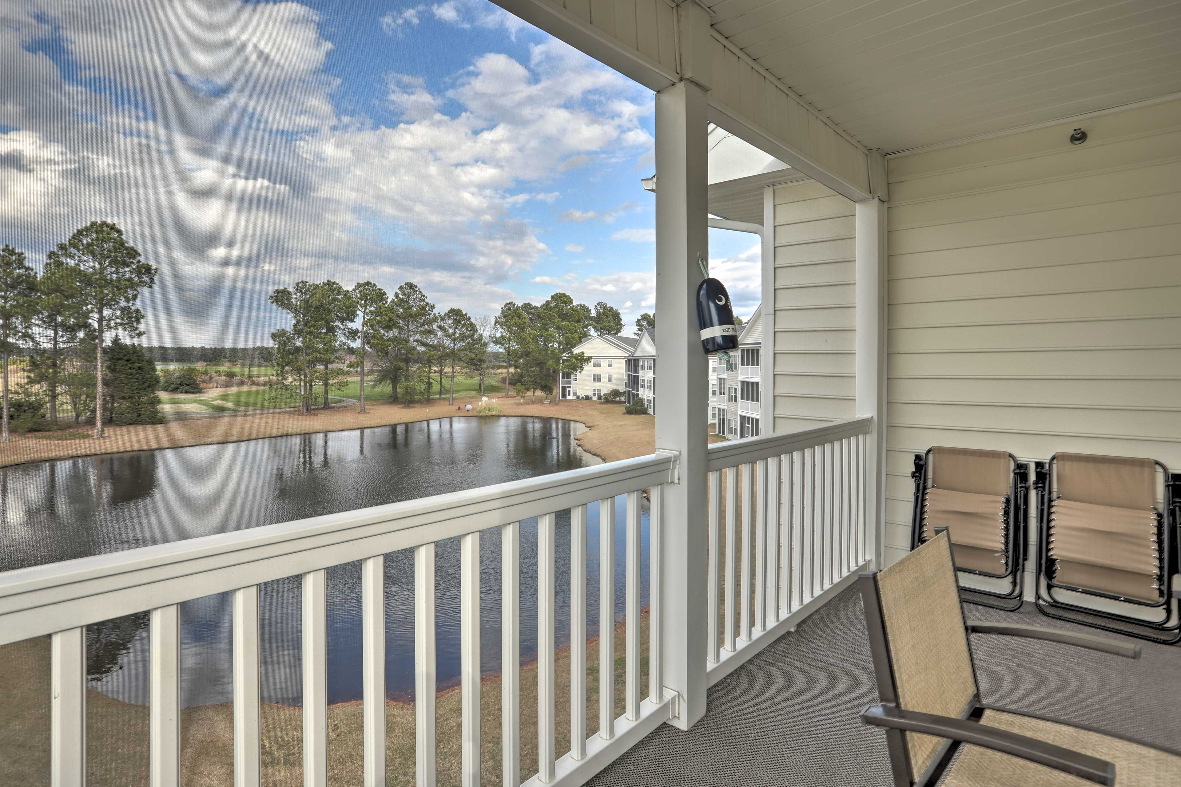 The private screened balcony overlooks the pond.